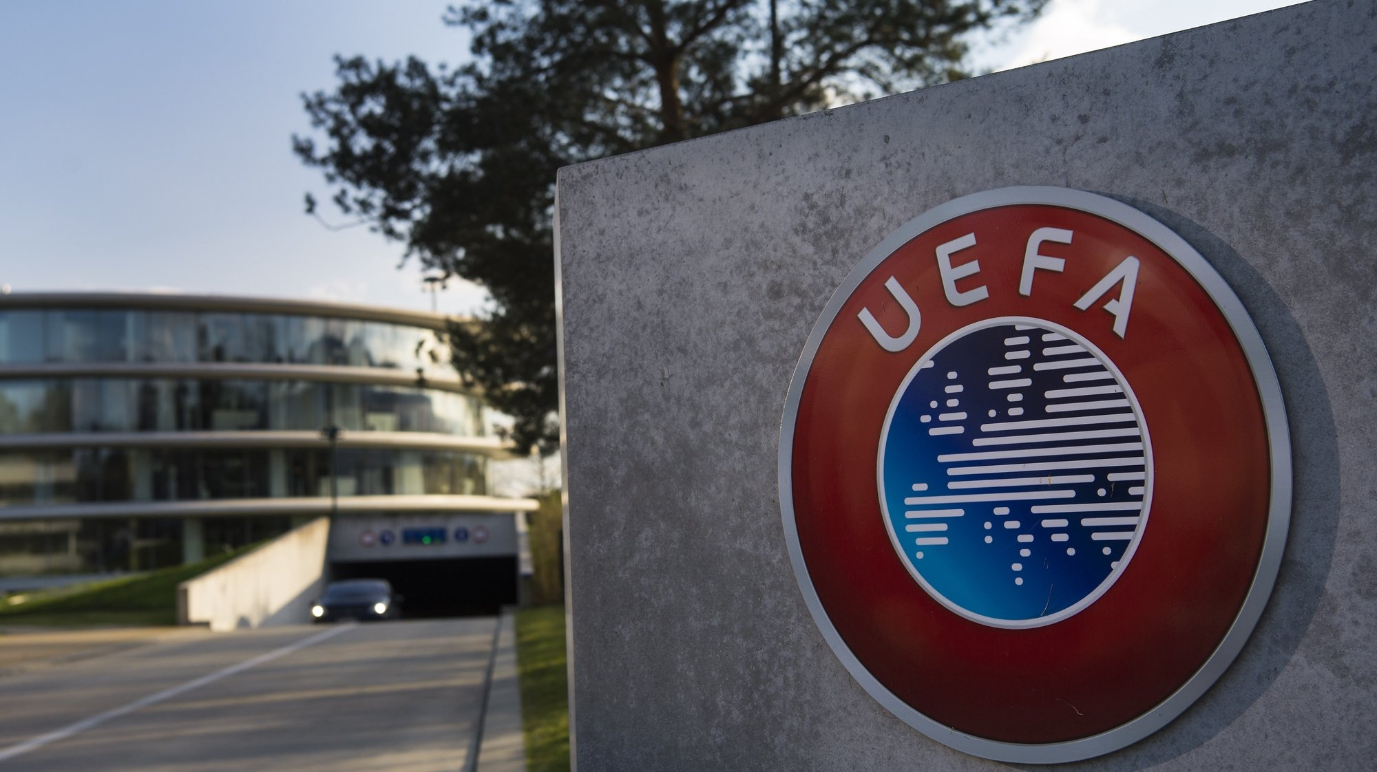 epa08300459 (FILE) - The UEFA logo on display next to the entrance of the UEFA Headquarters in Nyon, Switzerland, 06 April 2016 (re-issued on 17 March 2020). The UEFA EURO 2020 has been postponed to 2021 amid the coronavirus COVID-19 pandemic, the Norwegian Football Association (NFF) announced on 17 March 2020.  EPA/JEAN-CHRISTOPHE BOTT *** Local Caption *** 52687192