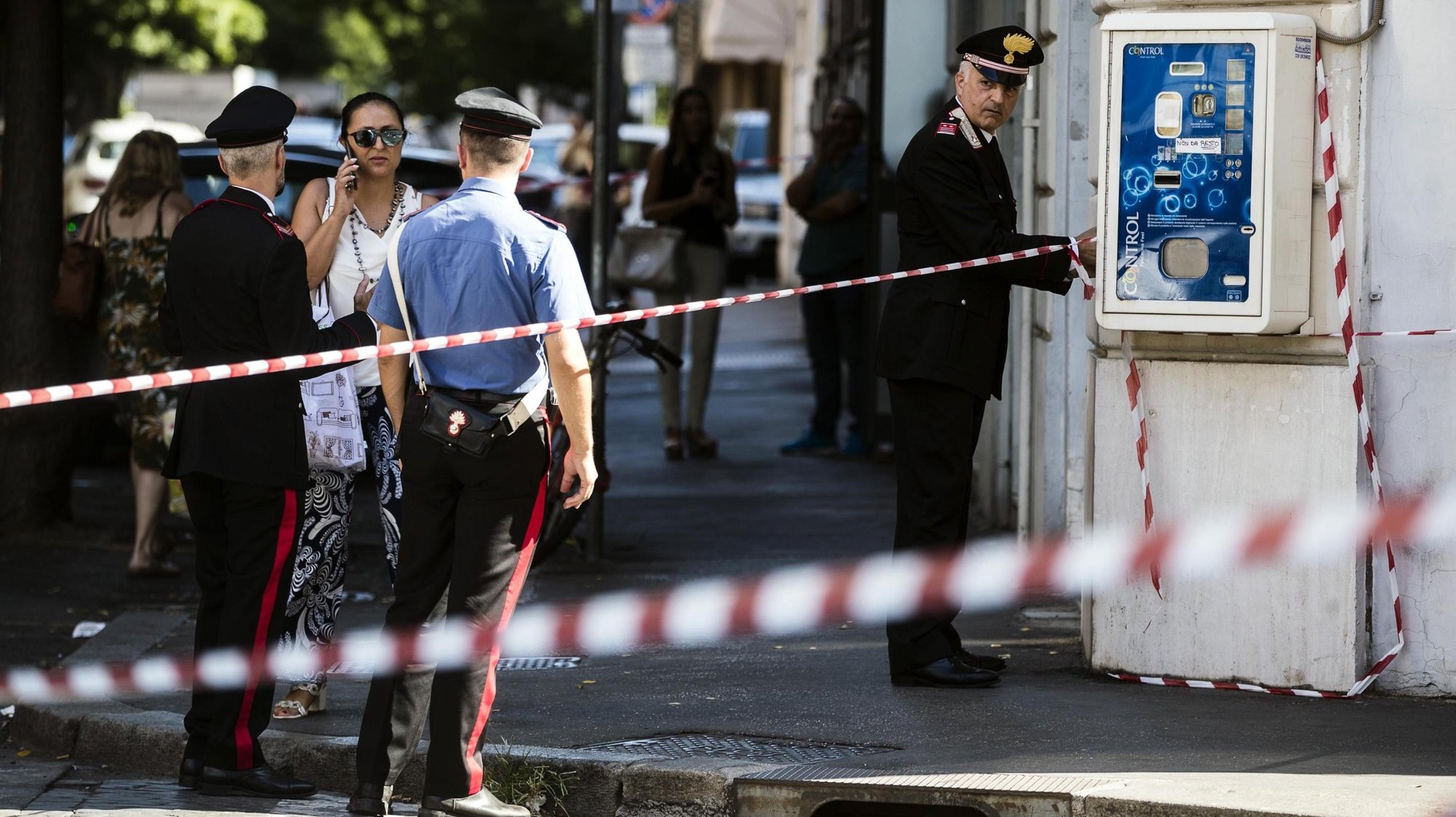epa09180033 (FILE) - Carabinieri officer and forensic police work a crime scene where Vice Brigadier of Carabinieri Mario Cerciello Rega was shot dead the night before in via Pietro Cossa, Rome, Italy, 26 July 2019 (reissued 06 May 2021). US college students Gabriel Natale-Hjorth and Finnegan Lee Elder were sentenced to life in prison on 05 May 2021 for the 2019 murder of Carabinieri paramilitary police officer Mario Cerciello Rega in Rome.  EPA/ANGELO CARCONI