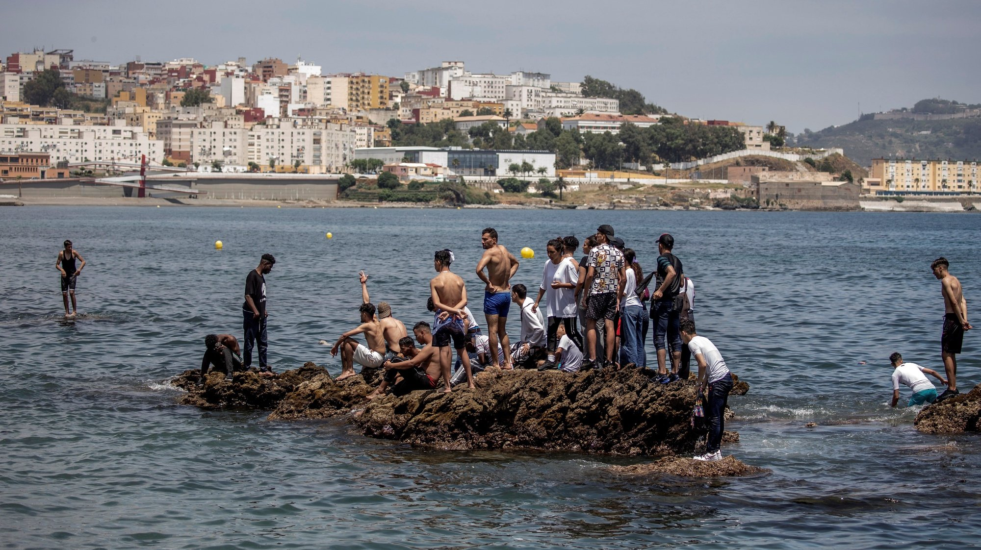 epa09209430 Migrants arrive swimming to cross the border of Tarajal in Ceuta, Spain, 18 May 2021. On the night of 17 May, a total of 5,000 Moroccan nationals entered into the Spanish city of Ceuta, loacted in the North African coast, by sea side and hundreds of migrants continue to attempt doing so. The Spanish authorities have deployed the army to patrol on the border separating Ceuta in the Spanish side from the Moroccan side, in a bid to control this latest surge of entry attempts.  EPA/BRAIS LORENZO