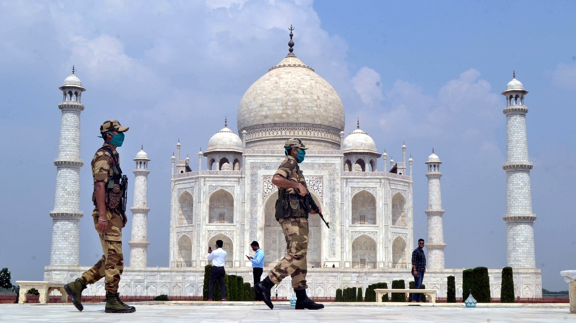 epa08685840 Indian security personnel stand guard at the Taj Mahal in Agra, Uttar Pradesh, India, 21 September 2020. The Taj Mahal reopened with increased safety measures after it was closed down by the authorities for six months amid the COVID-19 pandemic.  EPA/STR