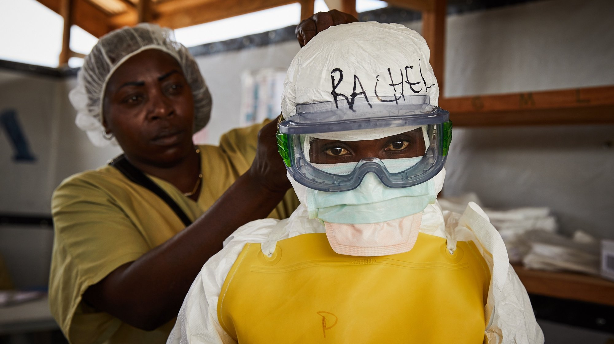 epa08891329 (20/39) Rachel Rukwati suits up in PPE to enter a high-risk treatment zone, at the peak of the Ebola crisis, at a health centre in Beni, North Kivu, Democratic Republic of Congo, 04 May 2019. Rachel was a health worker attached to the Ebola response and has first-hand experience of combating an unfamiliar virus. 'In the Ebola response I was a nurse, I took care of ill people, confirmed, and unconfirmed cases when they were at the CTE.In fact, the time we were entering the high-risk zone, we used to get fear, that fear was pushing us to leave the high-risk zone quickly. And when we wore the PPE costume or the protected material we were feeling muffled, then when you leave, you felt at ease because you return to your familiar feeling, compared to how you just felt breathing. The fear I had, was that I could get contaminated as a nurse. When I went to treatment zones I had fear.Since I left the response, I feel that I haven't recovered my health as it was before… the feeling we used to get in the treatment centers, we sense there are some things we lost.As coronavirus spreads, to the world, from myself as a health worker from Beni, and the Ebola response; I would tell them that when they notice the virus in their town, they should first accept it like a disease, not like politics, they will not be able to fight it like that. When you react to a disease, you will overcome it, using measures and precautions.' EPA/Hugh Kinsella Cunningham ATTENTION EDITORS / MANDATORY CREDIT : This story was produced in partnership with the Pulitzer Center -- For the full PHOTO ESSAY text please see Advisory Notice epa...
