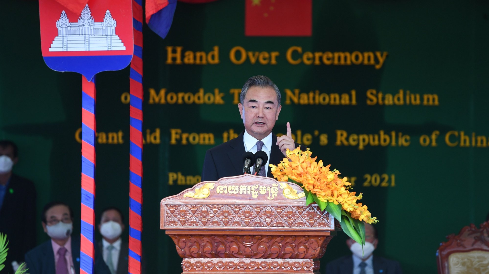 epa09463447 Chinese Foreign Minister Wang Yi speaks during a handover ceremony of the Morodok Techo National Stadium in Phnom P?enh, Cambodia, 12 September 2021. Wang Yi is on an official visit to Cambodia, during which he met with Cambodian Prime Minister Hun Sen and attended a handover ceremony of the Morodok Techo National Stadium funded by the Chinese government.  EPA/TANG CHHIN SOTHY / POOL