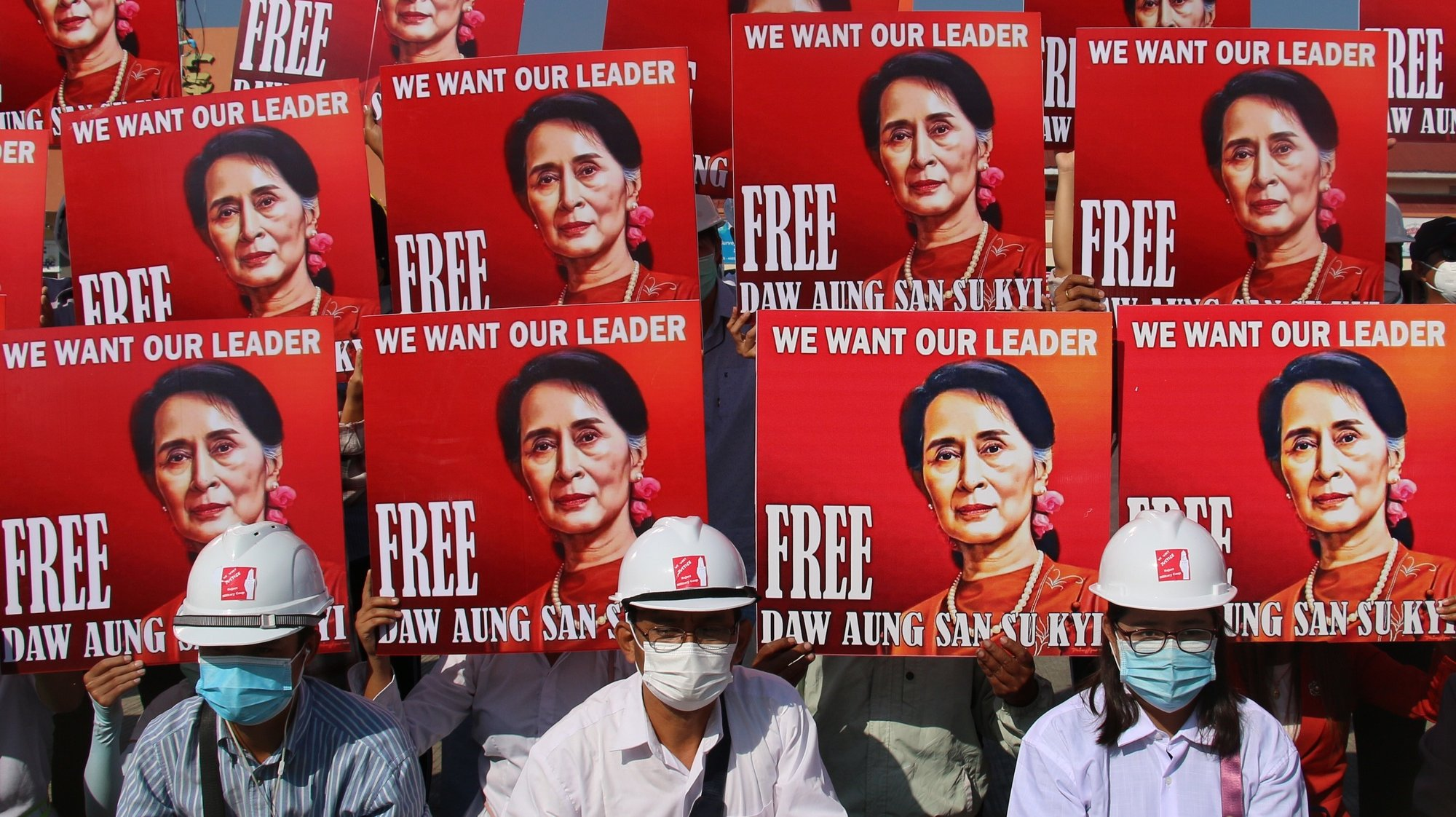 epa09269323 (FILE) - Demonstrators hold up placards calling for the release of detained Myanmar State Counselor Aung San Suu Kyi during a protest against the military coup in Naypyitaw, Myanmar, 15 February 2021(reissued 14 June 2021). The trial of deposed leader Aung San Suu Kyi will hear its first testimony in court on 14 June 2021. Aung San Suu Kyi was detained in February 2021 after her government was overthrown by the military in a coup.  EPA/STRINGER