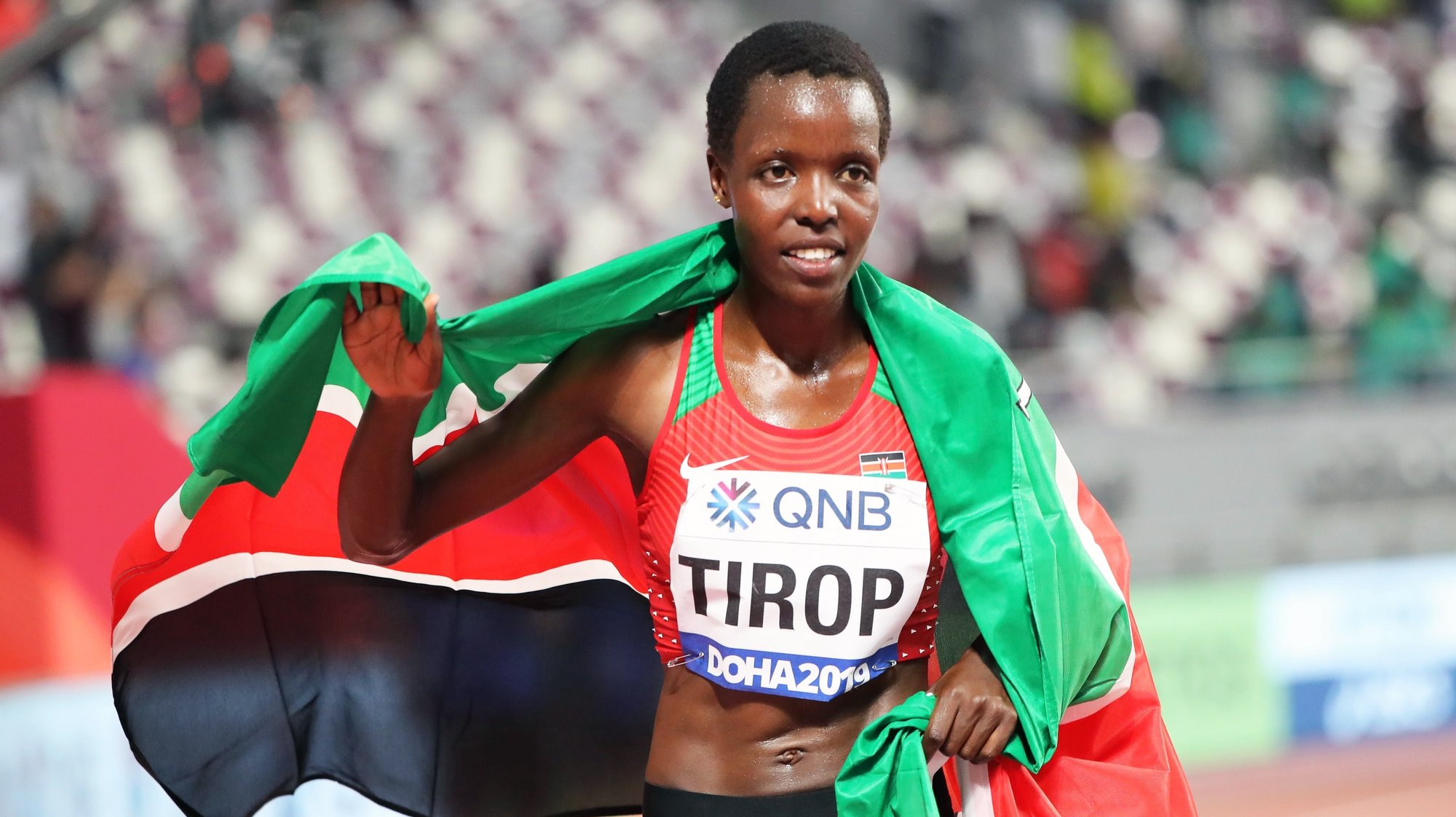 epa07878182 Agnes Jebet Tirop of Kenya celebrates after taking the third place in the women's 10,000m final during the IAAF World Athletics Championships 2019 at the Khalifa Stadium in Doha, Qatar, 28 September 2019. EPA/ALI HAIDER