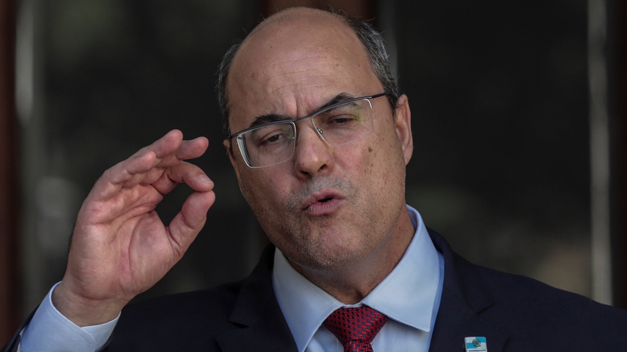 epa08632126 Wilson Witzel, temporarily separated by the Justice as governor of Rio de Janeiro due to his relationship to a corruption plot, speaks during a press conference in Rio de Janeiro, Brazil, 28 August 2020. Witzel considered himself 'a victim' of political interests of the high institutions and accused the Attorney General's Office of 'persecuting governors.' The Superior Court of Justice (STJ) of Brazil ordered on 28 August to dismiss for 180 days the conservative Witzel - a former ally of President Jair Bolsonaro - for irregularities in the management of public funds in the management to combat the coronavirus pandemic.  EPA/ANTONIO LACERDA