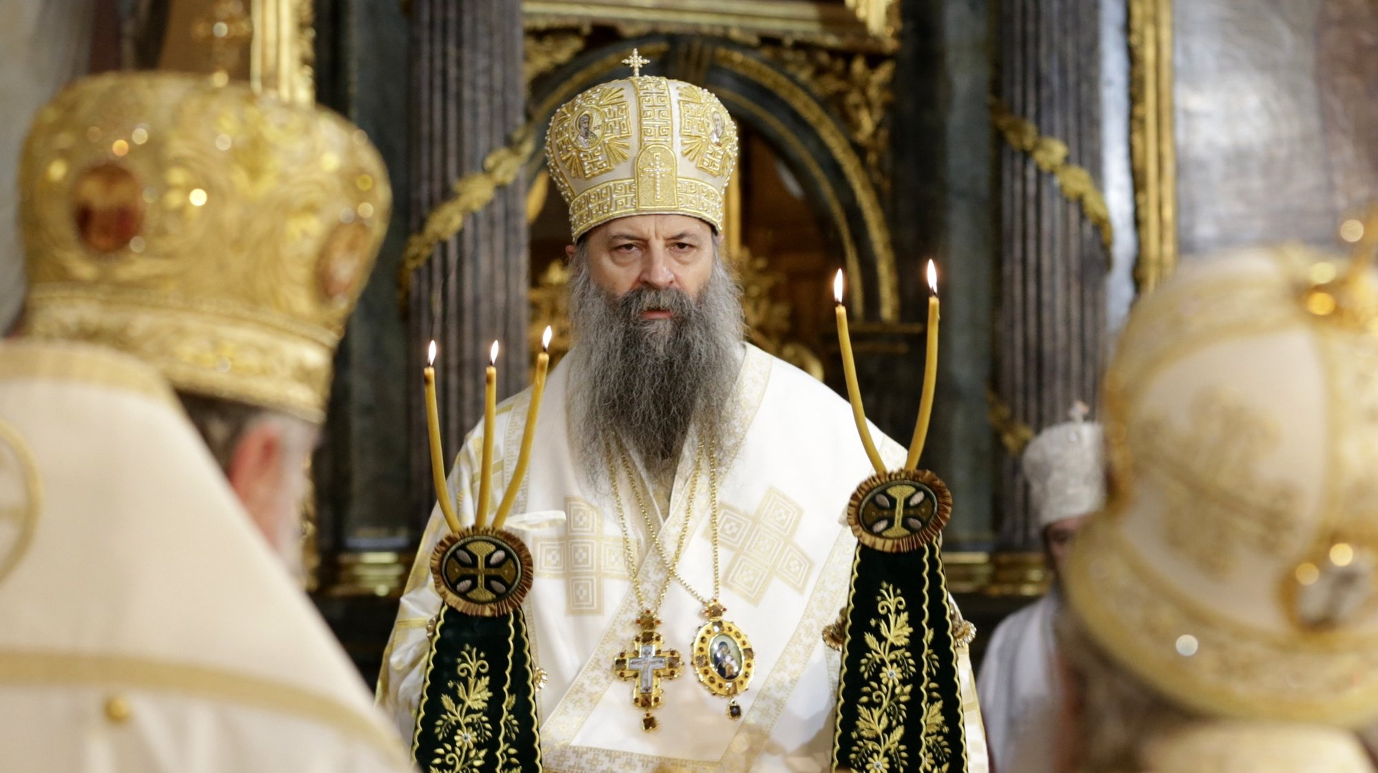 epa09023354 The new head of the Serbian Orthodox Church, Patriarch Porfirije leads a mass in Belgrade, Serbia, 19 February 2021. Serbian Orthodox Church enthroned its 46th leader after he was elected on 18 February 2021.  EPA/ANDREJ CUKIC