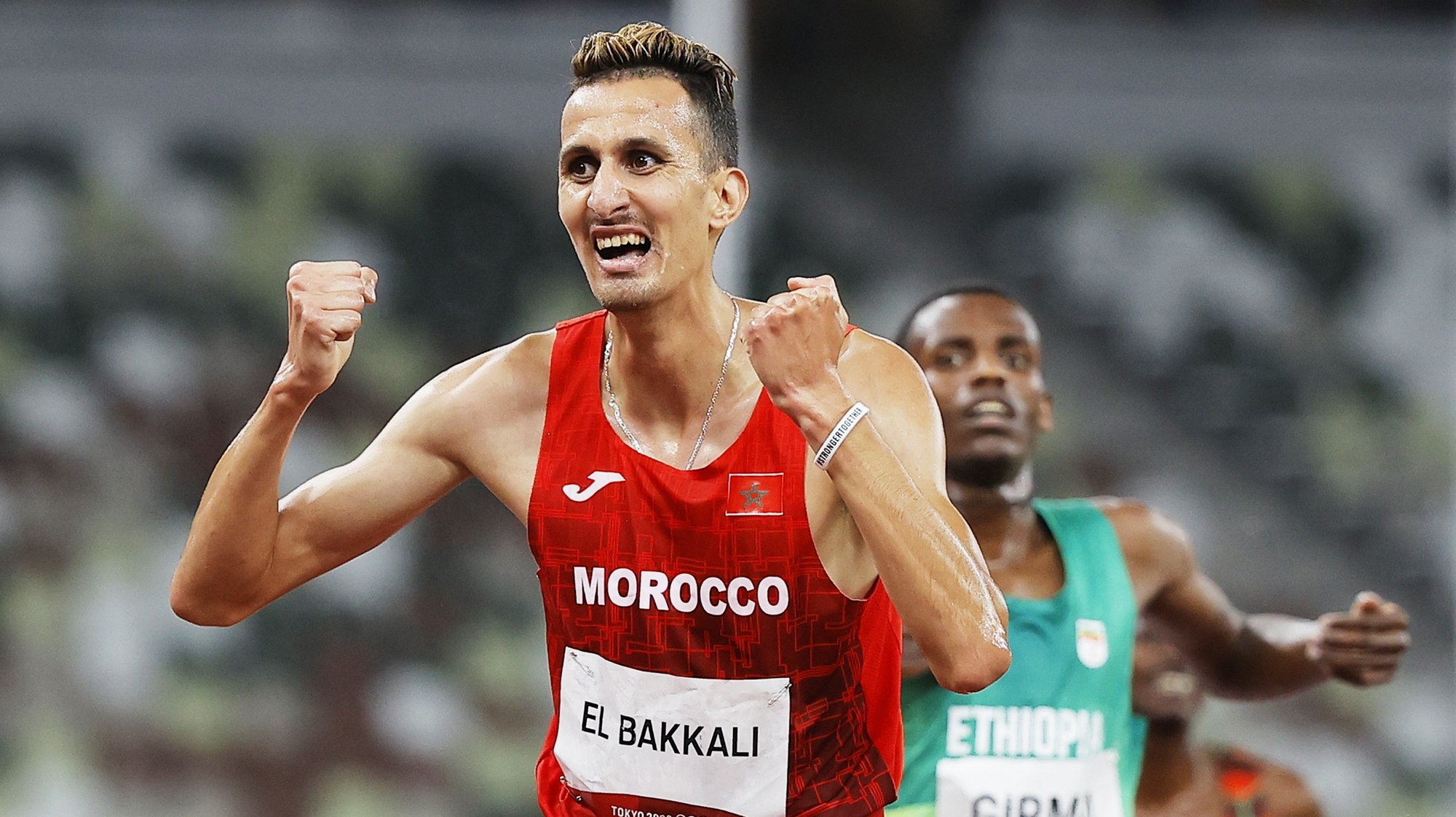 epa09388089 Soufiane El Bakkali of Morocco wins the Men's 3000m Steeplechase final at the Athletics events of the Tokyo 2020 Olympic Games at the Olympic Stadium in Tokyo, Japan, 02 August 2021. Lamecha Girma of Ethiopia placed second.  EPA/VALDRIN XHEMAJ