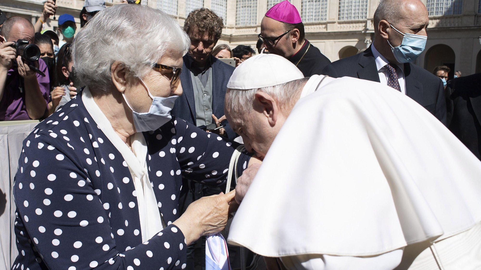 epa09229060 A handout picture provided by the Vatican Media shows Pope Francis kissing the number tattooed at the concentration camp on the arm of survivor Lidia Maksymowicz, in Vatican City, 26 May 2021. They exchanged a few words, embraced, then the Pontiff kissed the woman's arm with the number tattooed at the concentration camp.  EPA/VATICAN MEDIA HANDOUT  HANDOUT EDITORIAL USE ONLY/NO SALES