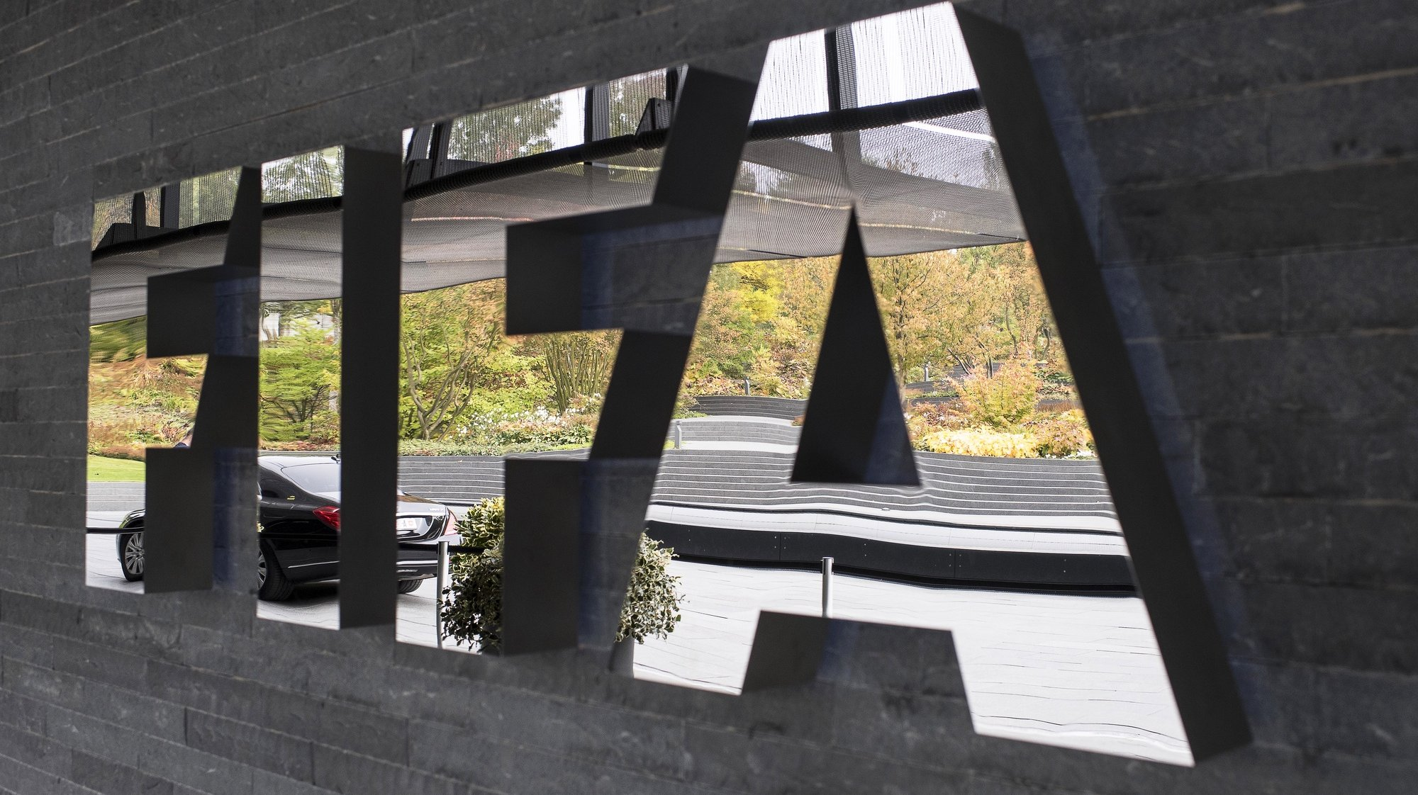 epa08334979 (FILE) - The FIFA logo on display prior to the FIFA Council meeting at the Home of FIFA in Zurich, Switzerland, 14 October 2016 (re-issued on 31 March 2020). The world governing body FIFA will set up a fund to assist competitions and players which have run into financial trouble because of the ongoing coronavirus COVID-19 pandemic, media reports stated on 31 March 2020.  EPA/ENNIO LEANZA *** Local Caption *** 53067573