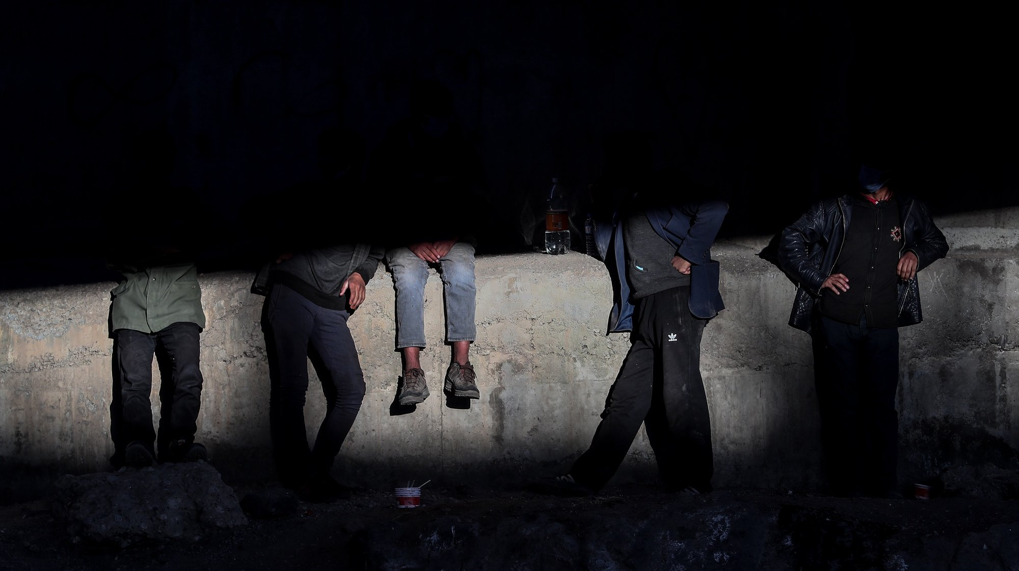 epaselect epa09323135 (28/33) A group of people rest under a bridge near a railway in the Turkish city of Van after crossing the Iran-Turkey border, 02 June 2021. People smuggled into the country wait for days to be transferred by smugglers to Diyarbakir city to reach west Turkey. The city of Van, on the Turkish-Iranian border, is one of the points at which human smuggling can be easily spotted. Smugglers charge between 600 or 1,000 US dollars per person, depending on the security situation at the border.  EPA/SEDAT SUNA ATTENTION: For the full PHOTO ESSAY text please see Advisory Notices epa09323103 and epa09323104