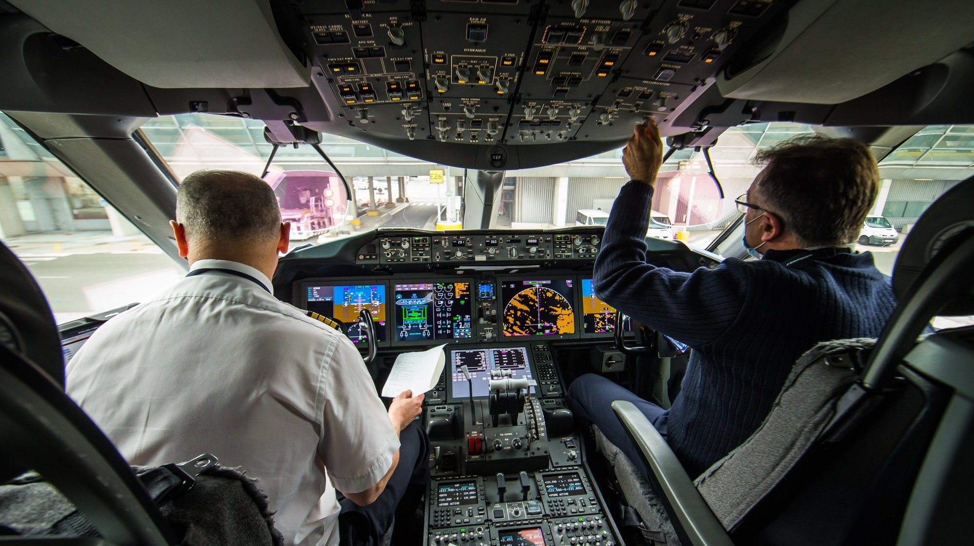 epa09130179 Air France pilots prepare for take-off in the cockpit of a Boeing 787 carrying refrigerated containers of Chinese SinoVac vaccines to Bogoto, Colombia at Roissy Airport, near Paris, 11 April 2021 (issued 12 April 2021). Airline company Air France KLM Cargo, operated two flies to Cameroon and Colombia with a shipment of Chinese covid19 vaccines SinoPharm and SinoVac through its cargo area of Roissy airport (CDG).  EPA/CHRISTOPHE PETIT TESSON