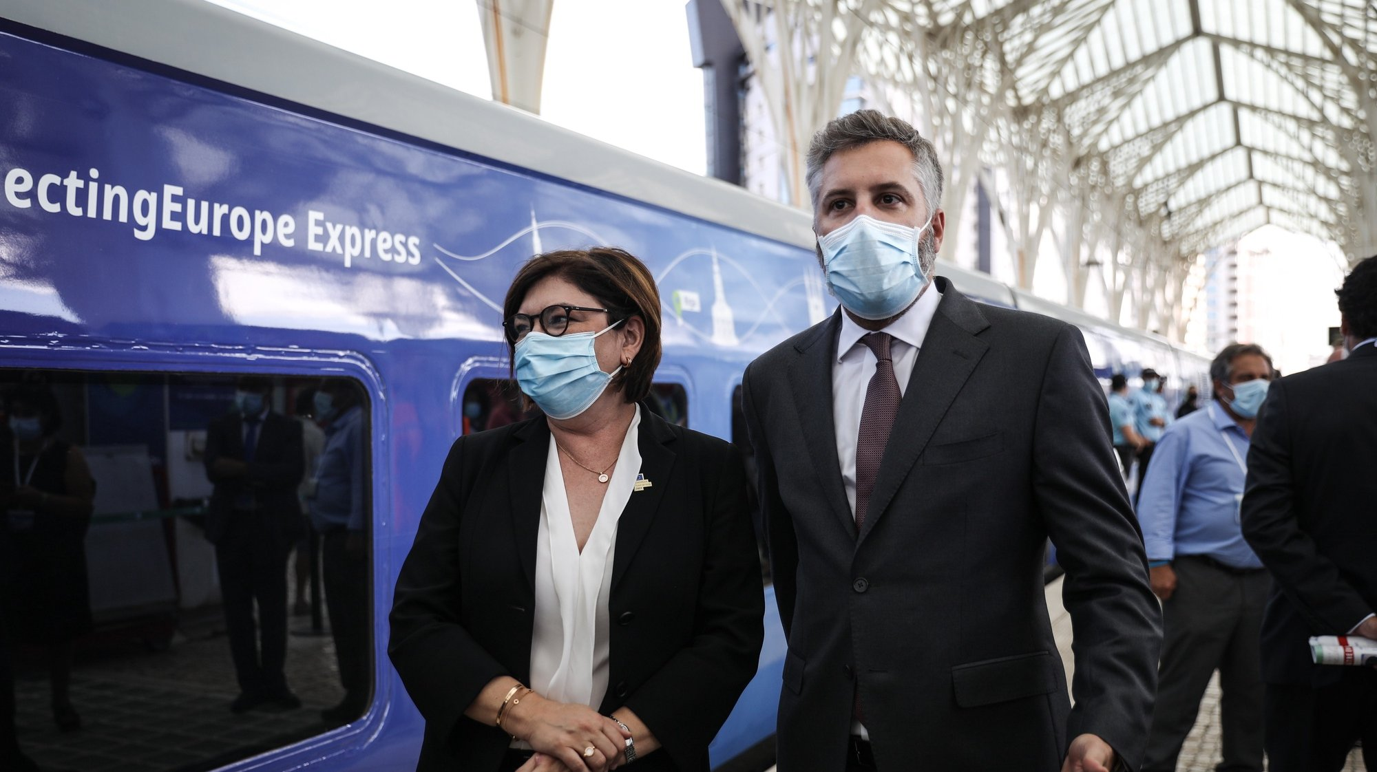epa09443294 European Commissioner for Transports Adina Valean (L) and Portuguese Minister of Infrastructure and Housing Pedro Nuno Santos (R) moments before the train departure during the Connecting Europe Express ceremony in Gare do Oriente train station in Lisbon, Portugal, 02 September 2021.  EPA/RODRIGO ANTUNES