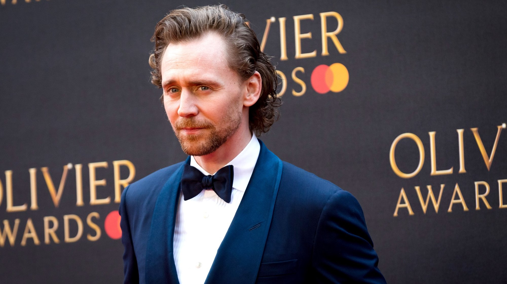epa07490901 British actor Tom Hiddleston arrives at the Olivier Awards at the Royal Albert Hall in London, Britain, 07 April 2019. The Olivier Awards are awarded for outstanding achievements in British theatre.  EPA/VICKIE FLORES