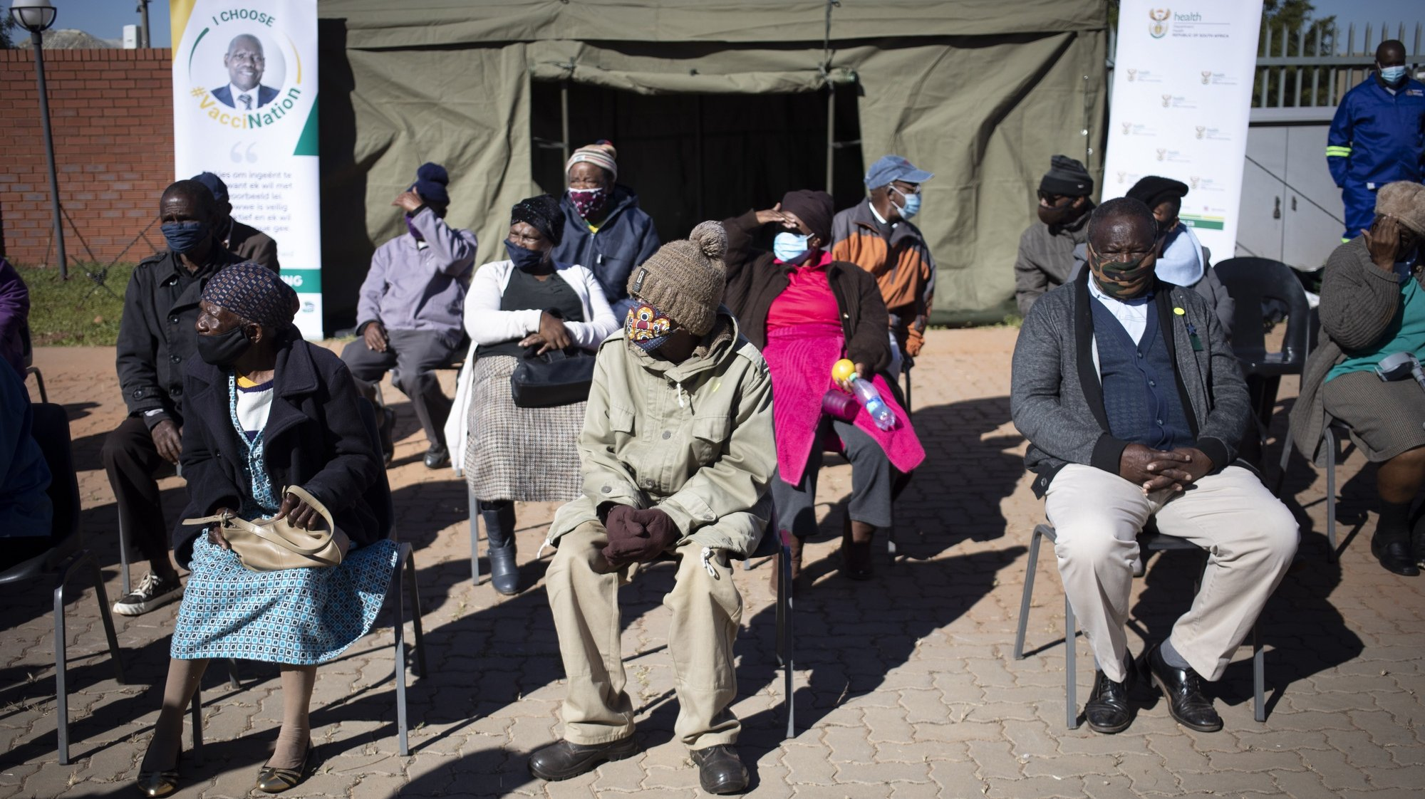 epa09206341 Elderly members of the community wait in line to receive their vaccination during the first day of Covid-19 vaccinations for the over 60 year old population in the country, in Johannesburg, South Africa, 17 May 2021. The first round of vaccinations was for the health care workers in the country. South Africa is lagging behind many countries in the world in its vaccination program.  EPA/Kim Ludbrook