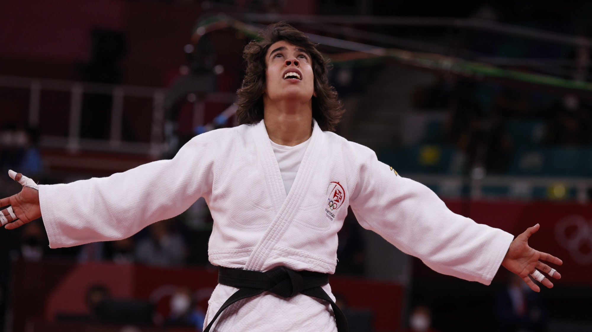 epa09361400 Catarina Costa of Portugal celebrates after defeating Paula Pareto of Argentina during their Repechage bout in the Women -48 kg at the Judo competitions of the Tokyo 2020 Olympic Games at the Nippon Budokan arena in Tokyo, Japan, 24 July 2021.  EPA/JEON HEON-KYUN