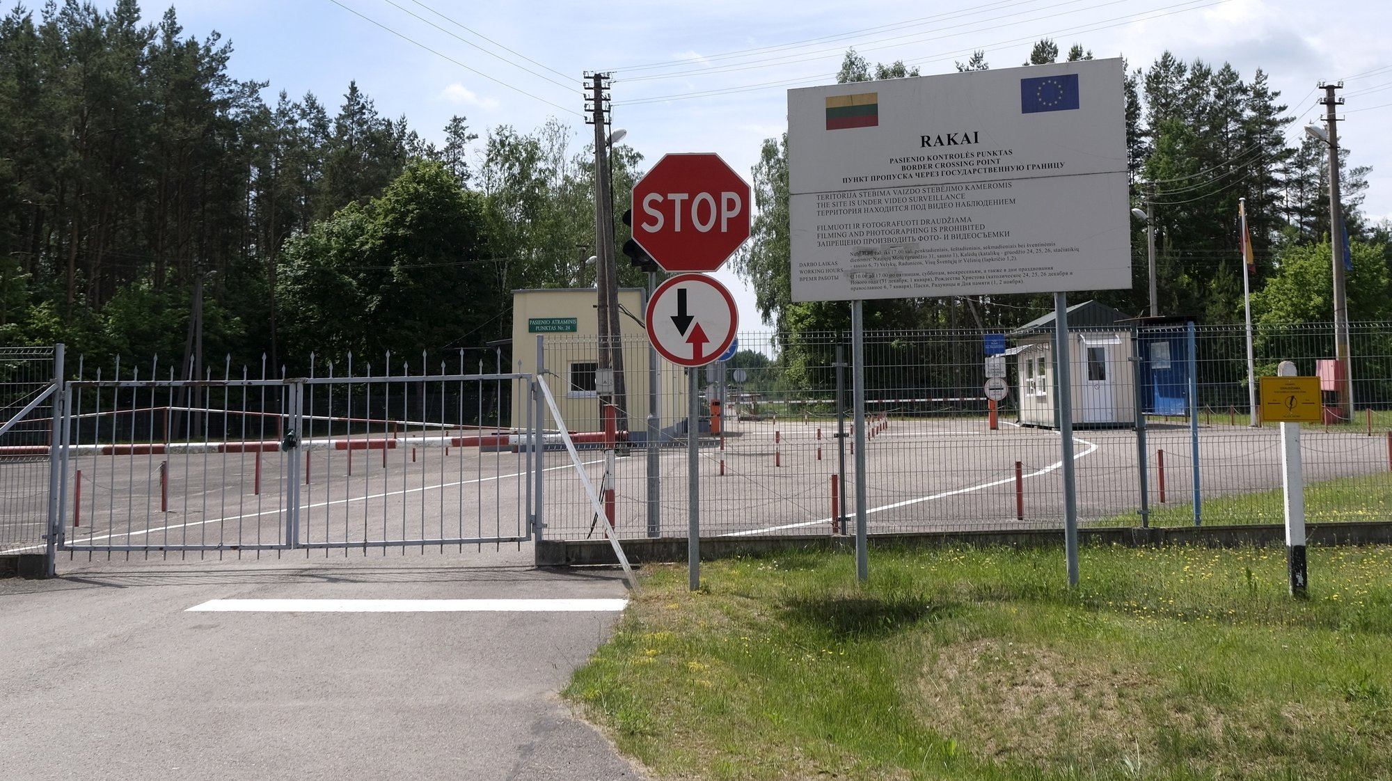 epa09274906 A border crossing point between Rakai, in Lithuania, and Petjulevci, in Belarus, is temporarily closed due to the measures to curb the spreading of the Covid-19 pandemic, in Rakai, Lithuania, 15 June 2016. According to official Lithuanian data, more than 380 illegal migrants from Belarus tried to enter Lithuania unril now in this year. The number is almost five times higher than in the entire year 2020.  EPA/VALDA KALNINA
