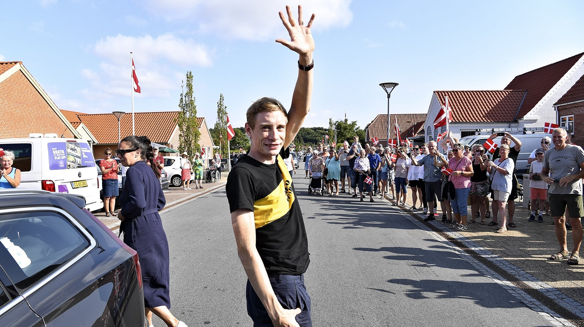 epa09360428 Jonas Vingegaard waves to the crowd in his home town of Glyngoere in Denmark, 23 July 2021. Jumbo Visma's Danish rider, Jonas Vingegaard is celebrated by family, friends and fans in his home town of Glyngoere in Denmark after his overall second place in this year's Tour de France. A large part of the 1.500 inhabitants greeted Jonas Vingegaard with cheers and flags.  EPA/ERNST VAN NORDE  DENMARK OUT