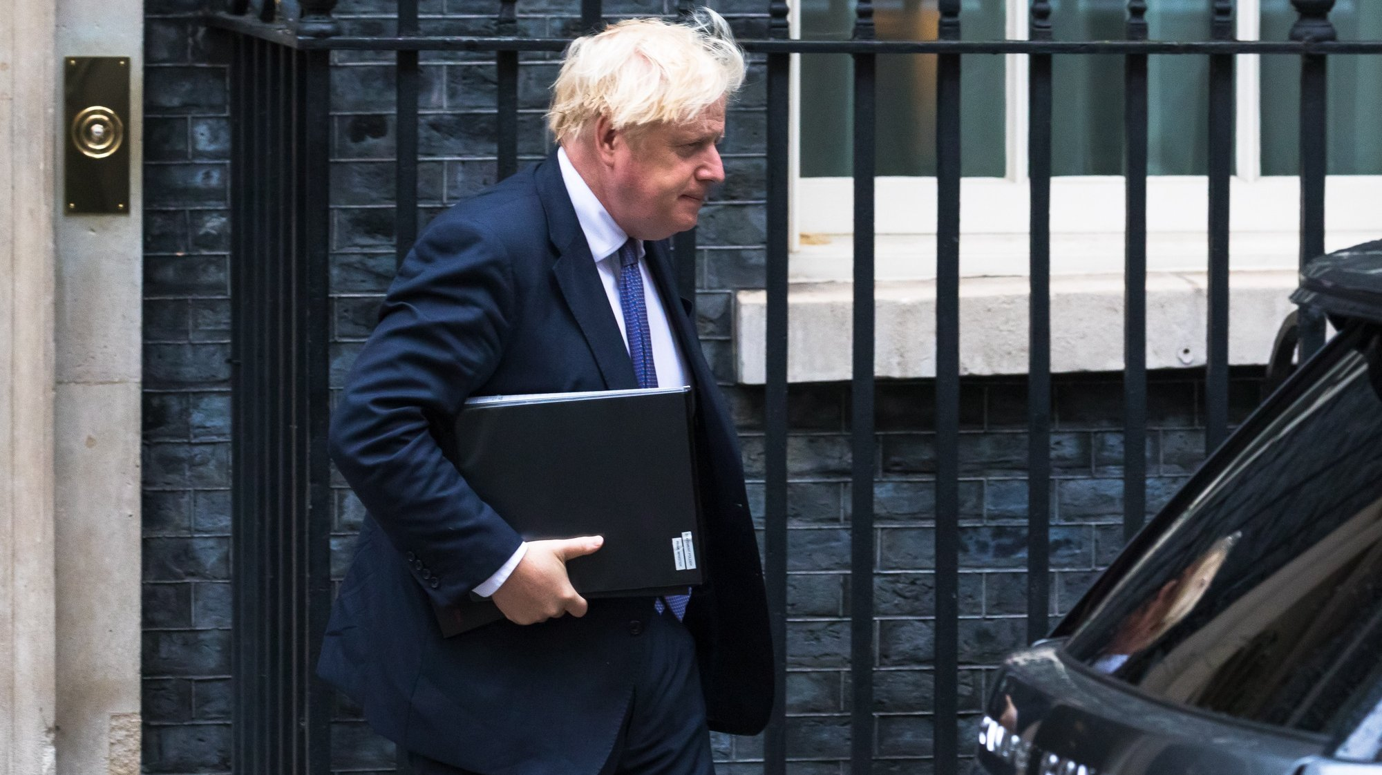 epa09418766 British Prime Minister Boris Johnson departs 10 Downing Street in London, Britain, 18 August 2021. Prime Minister Boris Johnson has recalled parliament from recess to discuss the ongoing situation in Afghanistan.  EPA/VICKIE FLORES