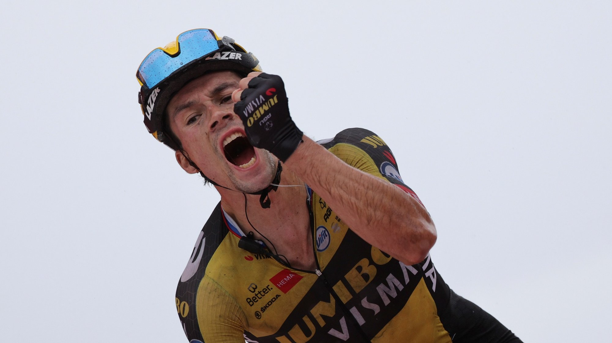 epa09440816 Slovenian rider Primoz Roglic of Team Jumbo-Visma celebrates after winning the 17th stage of the 2021 La Vuelta cycling tour over 185.8km between Unquera and Lagos de Covadonga, Spain, 01 September 2021.  EPA/Manu Bruque