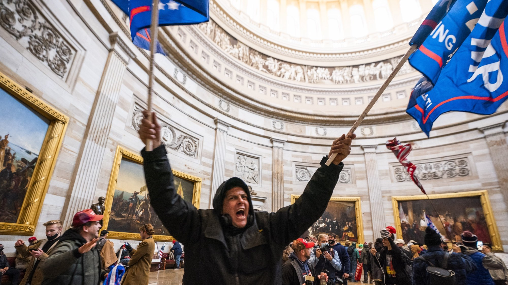 epaselect epa08923451 Supporters of US President Donald J. Trump in the Capitol Rotunda after breaching Capitol security in Washington, DC, USA, 06 January 2021. Protesters entered the US Capitol where the Electoral College vote certification for President-elect Joe Biden took place.  EPA/JIM LO SCALZO