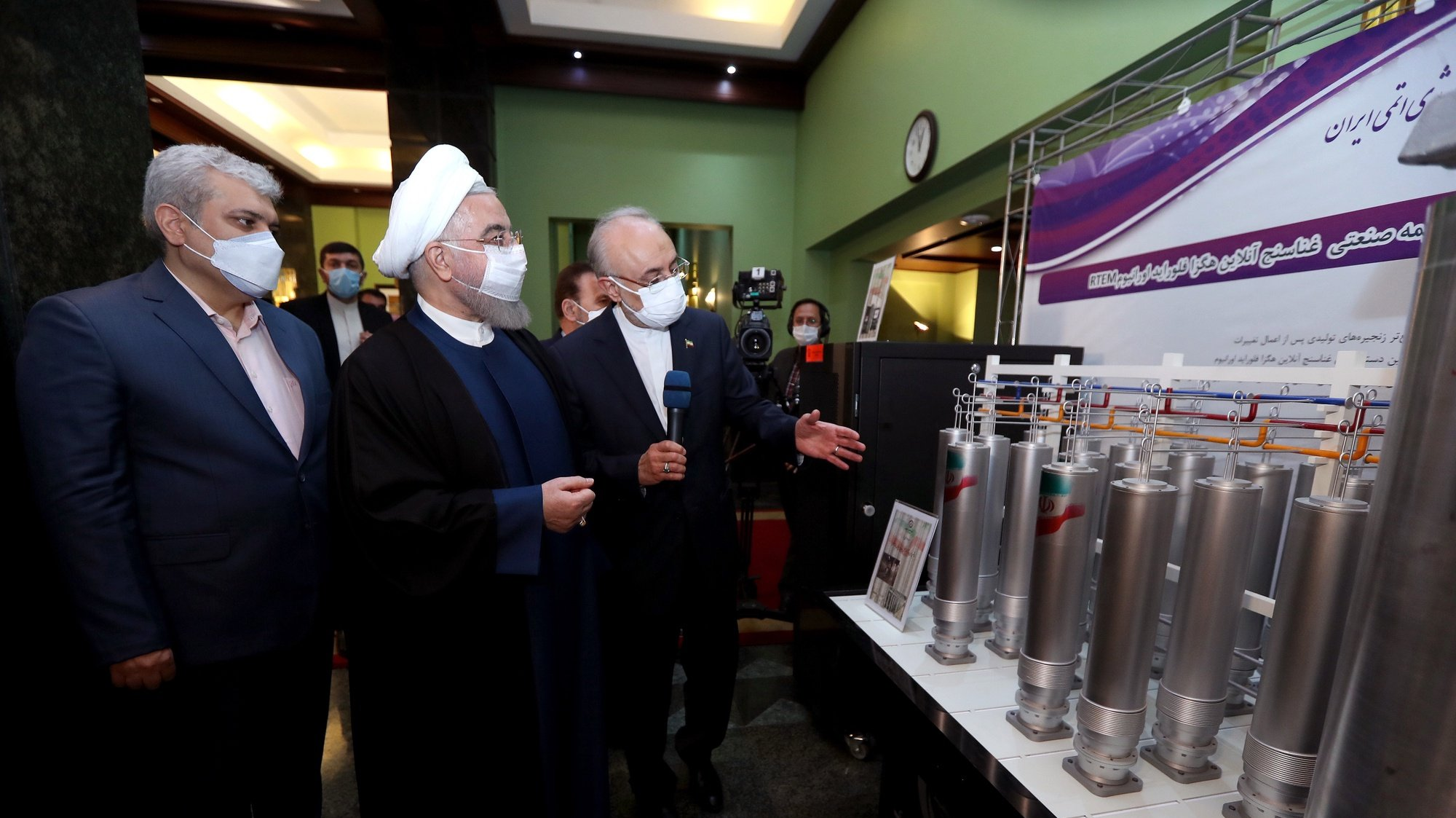 epa09126292 A handout picture made available by the Iranian presidential office shows Iranian President Hassan Rouhani (C) and head of Iran's nuclear organization Ali Akbar Salehi (R) visits an exhibition of nuclear achievement on the occasion of Iran Nuclear Technology Day, in Tehran, Iran, 10 April 2021. According to Isna news agency, Rouhani said that 'US and west owe us about nuclear deal and they must make it up', referring to the sanctions against the country over Iran's disputed nuclear programm.  EPA/IRAN PRESIDENT OFFICE HANDOUT  HANDOUT EDITORIAL USE ONLY/NO SALES