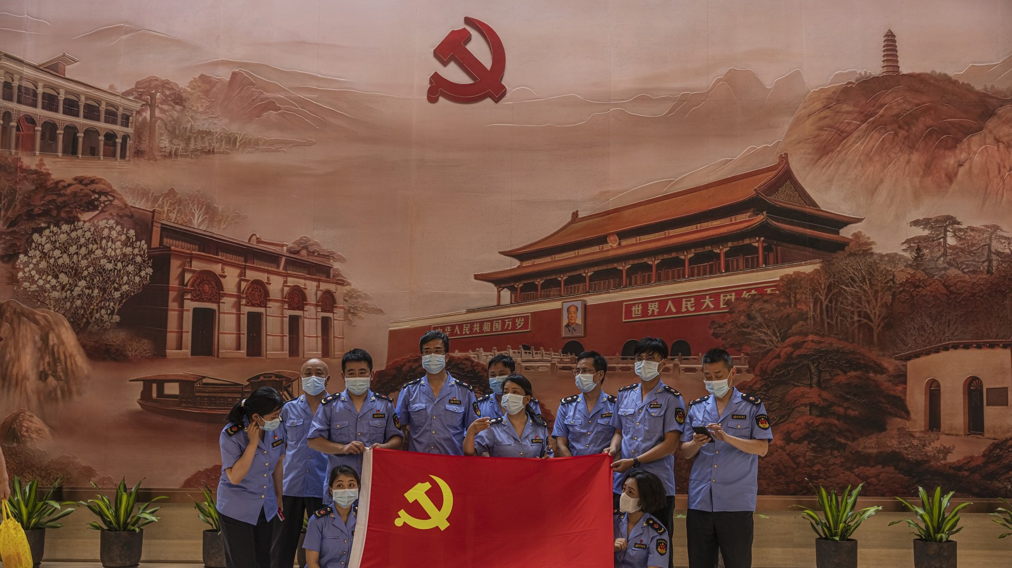 epa09314821 Members of the police pose in the Memorial of the 1st National Congress of the CPC (Chinese Communist Party), in Shanghai, China, 01 July 2021. China celebrates on 01 July the 100th anniversary of the founding of the ruling Chinese Communist Party.  EPA/ALEX PLAVEVSKI