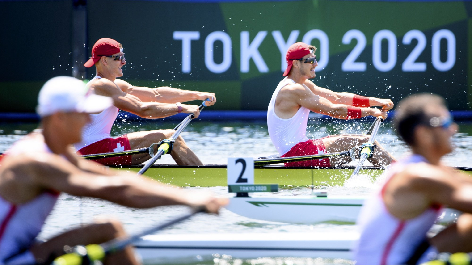 epaselect epa09359026 Swiss rowers Barnabe Delarze and Roman Roeoesli compete in the men's rowing double sculls heat at the 2020 Tokyo Summer Olympics in Tokyo, Japan, 23 July 2021.  EPA/LAURENT GILLIERON EDITORIAL USE ONLY