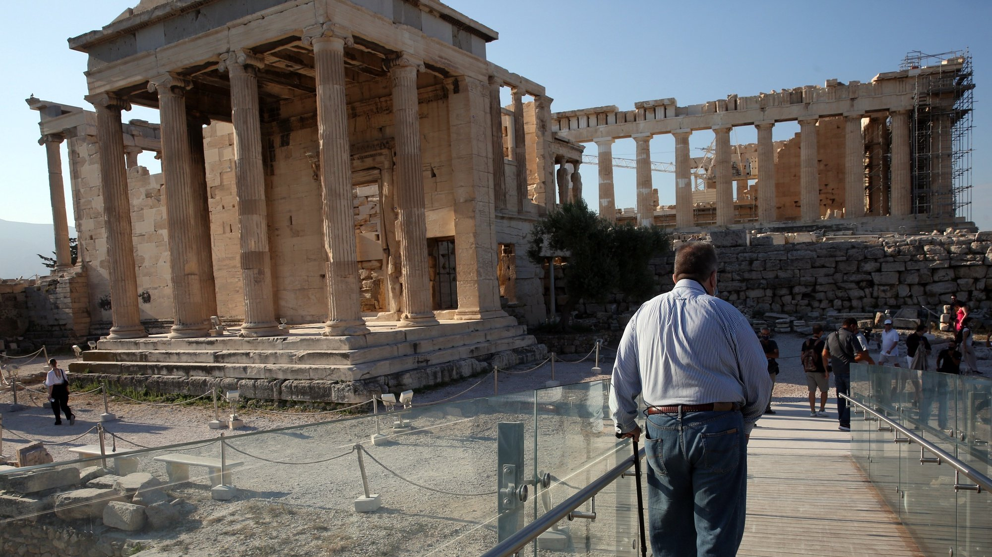 epa09354417 A man with mobility problems just used the elevator to visit the archaeological site of the Acropolis hill in Athens, Greece, 20 July 2021. People with similar problems have the opportunity to visit Acropolis due to the recent improvement works for the access of visitors with mobility issues, special needs and the elderly.  EPA/ORESTIS PANAGIOTOU