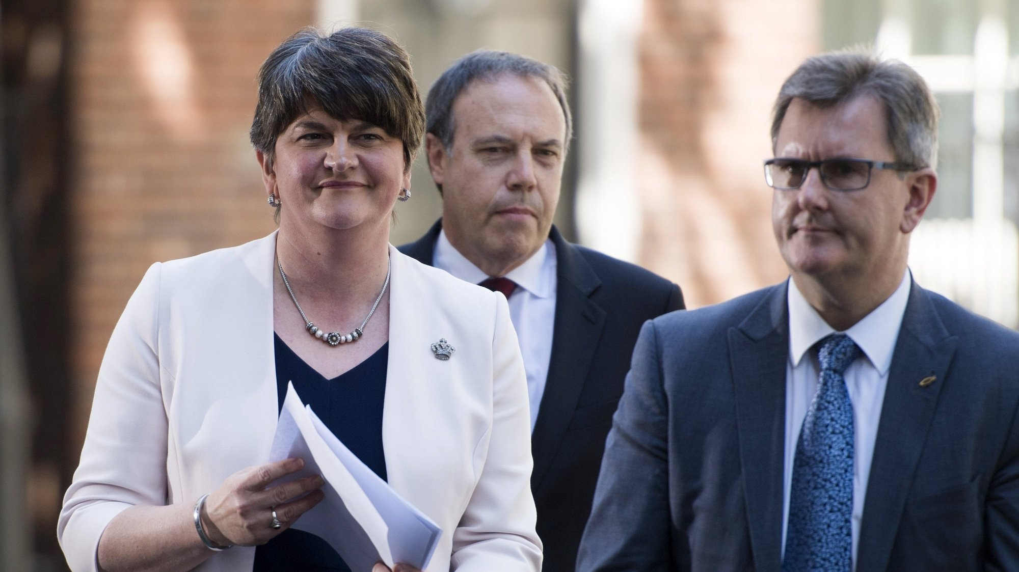 epa06051164 Leader of the Northern Ireland Democratic Unionist Party (DUP) Arlene Foster (L) Deputy Leader Nigel Dodds (C) and Chief Whip Jeffrey Donaldson (R) prepare to address members of the media outside 10 Downing Street, central London, Britain 26 June 2017. It has been announced that the DUP and Conservative party lead by Prime Minister Theresa May have agreed terms for an agreement to form a government.  EPA/WILL OLIVER