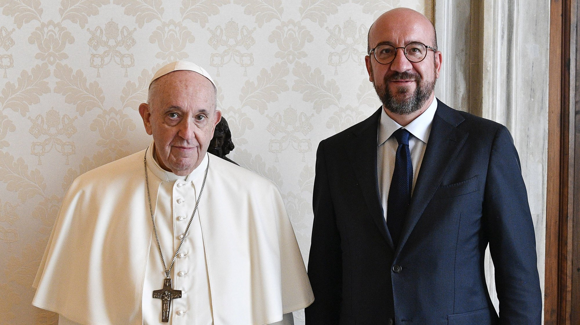 epa09460685 A handout picture provided by the Vatican Media shows Pope Francis (L) and European Council President Charles Michel (R) posing for a photograph during their meeting in Vatican City, 11 September 2021.  EPA/VATICAN MEDIA HANDOUT  HANDOUT EDITORIAL USE ONLY/NO SALES