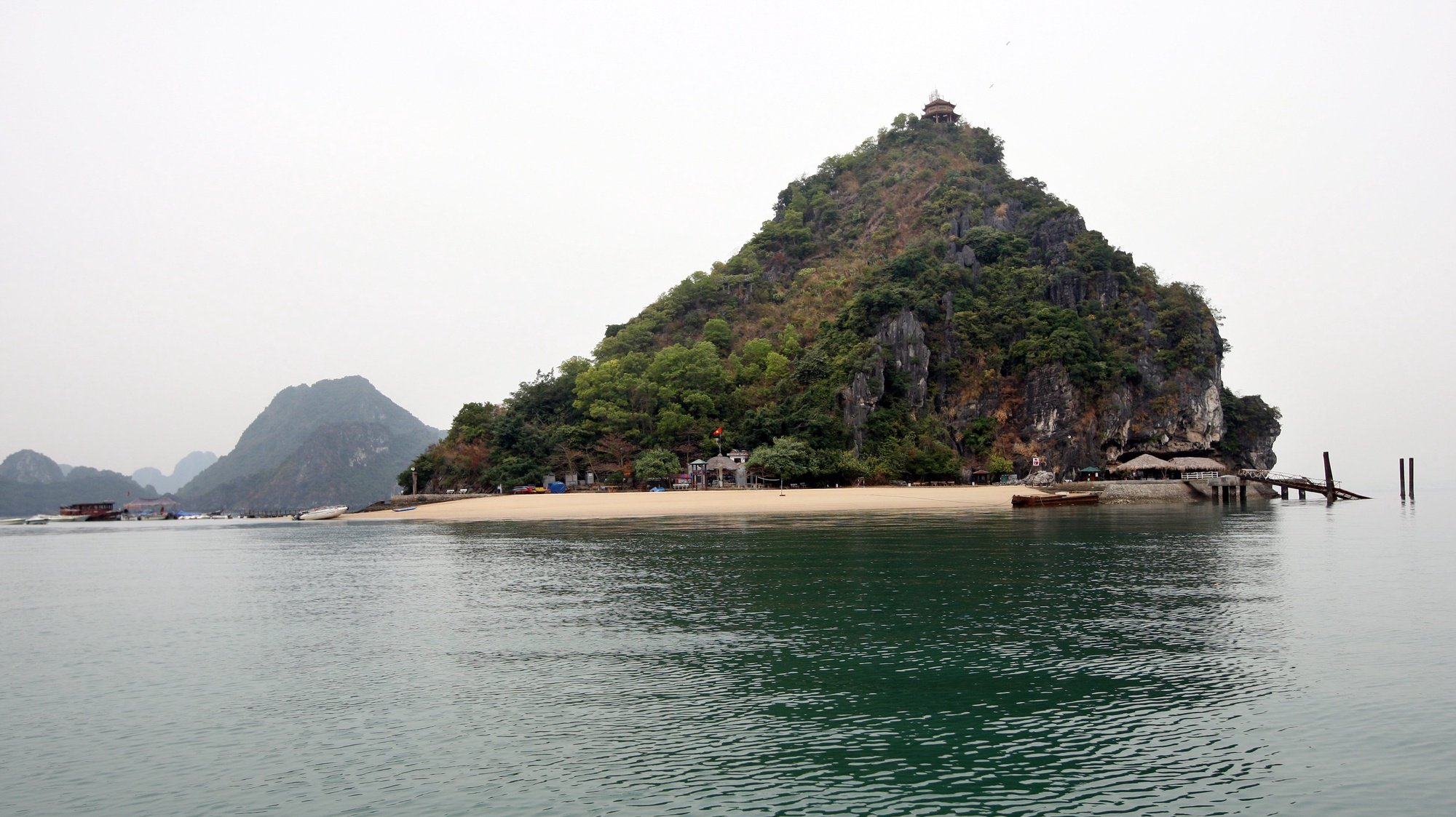 epa02589163 A view of Titop island, where nearby the tourist boat 'Dream Voyage' sunk, in Ha Long Bay, in northern Vietnam, 18 February 2011. Vietnamese police detained for questioning the captain and four crew members involved in a boat tragedy that left 12 tourists dead the previous day. The accident occurred on 17 February at Ha Long Bay when a tourist boat carrying 27 people sank. Nguyen Khuong Duy, a Vietnamese Australian, one of 15 survivors in the tragedy told local media the accident happened when people were still sleeping in the boat. Those on the top deck had time to escape before the boat sank.  EPA/LUONG THAI LINH
