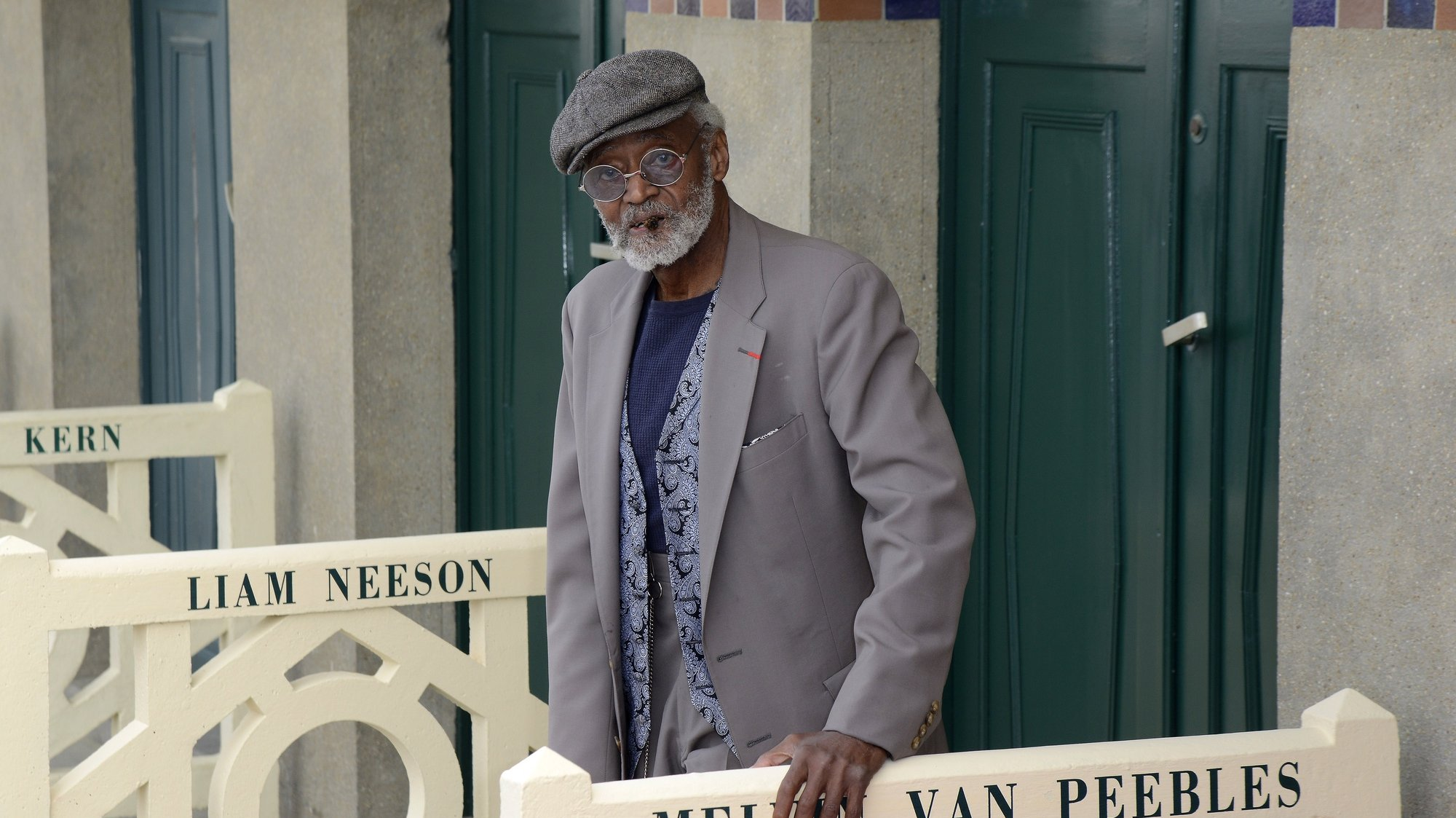 epa09482586 (FILE) - US actor Melvin Van Peebles poses in front of a newly unveiled beach changing-booth in his name, along the Deauville beach front, during the 38th Deauville American Film Festival, in Deauville, France, 05 September 2012 (Reissued 22 September 2021). US filmmaker Melvin Van Peebles died at the age of 89.  EPA/STEPHANE REIX *** Local Caption *** 50508839