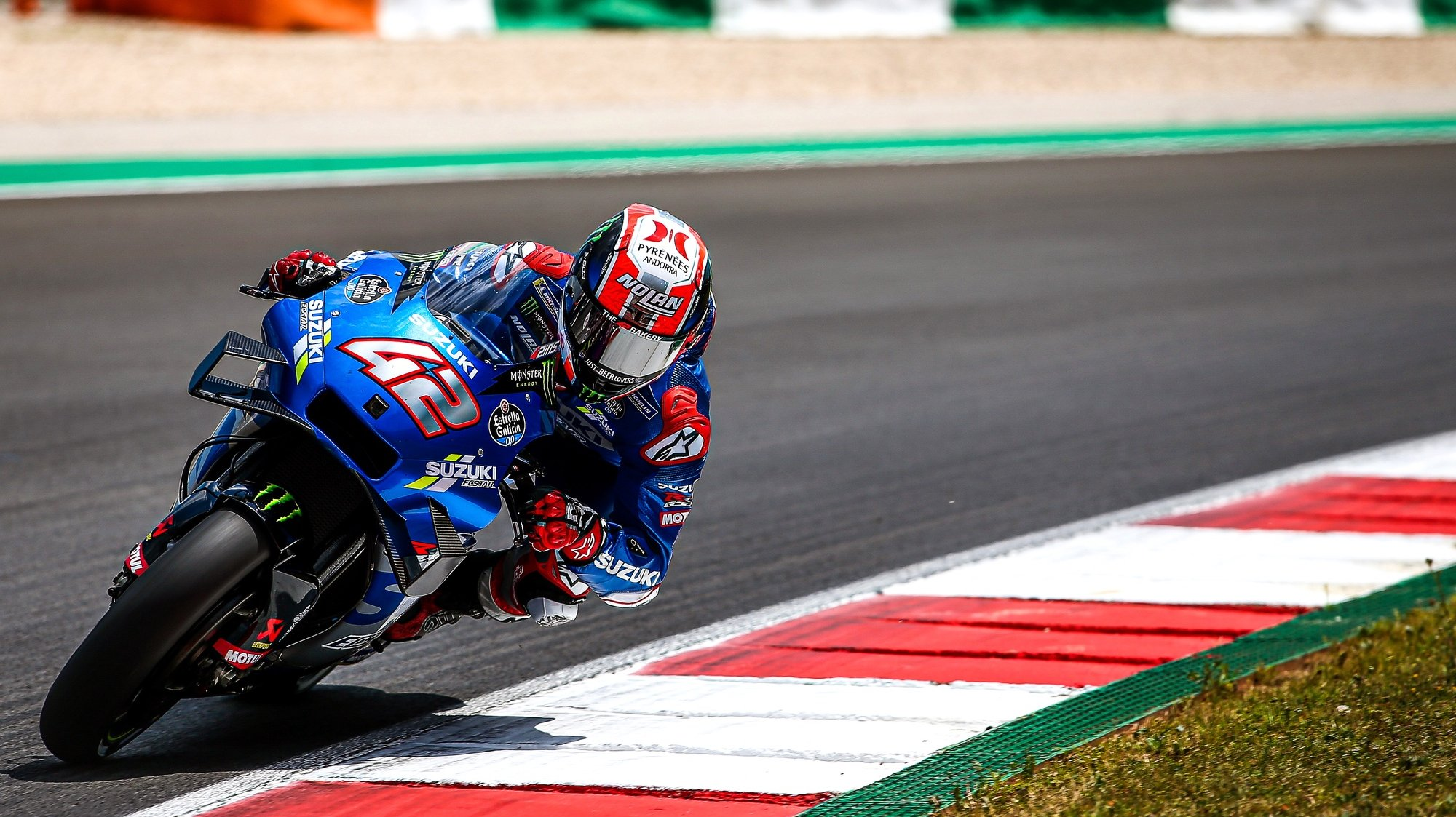 epa09141605 Spanish MotoGP rider Alex Rins of the Suzuki Ecstar team in action during the qualifying session of the Motorcycling Grand Prix of Portugal at Algarve International race track in Portimao, southern Portugal, 17 April 2021. The Motorcycling Grand Prix of Portugal will take place on 18 April 2021.  EPA/JOSE SENA GOULAO
