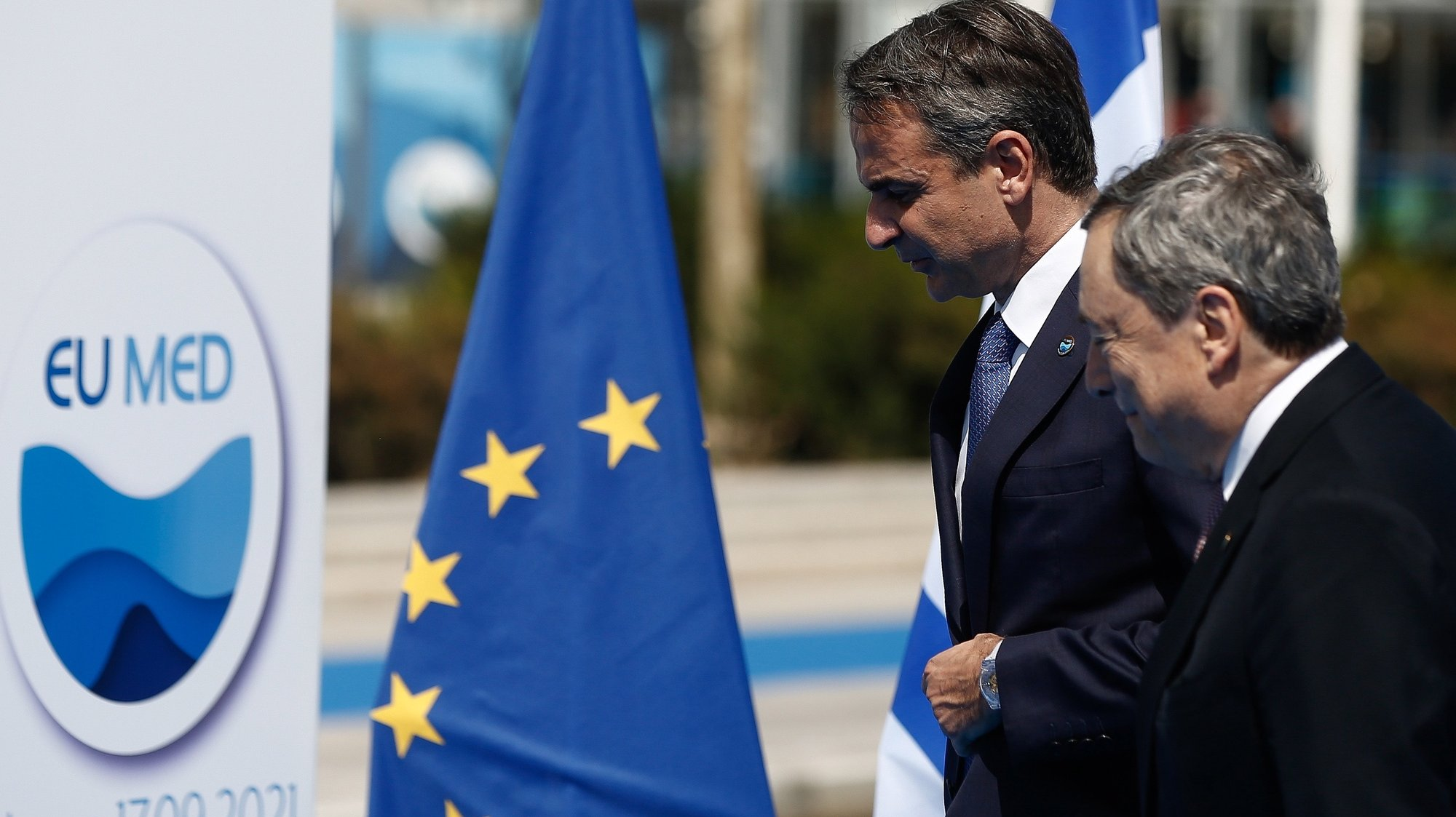 epa09473128 Greek Prime Minister Kyriakos Mitsotakis (L) welcomes Italian Prime Minister Mario Draghi (R), at the EUMed9 Summit, in Athens, Greece, 17 September 2021.The agenda of the Summit, which acquires special geopolitical weight, includes security challenges in the Mediterranean that endanger stability in the region, potential new crises, such as the threat of migration flows after the latest developments in Afghanistan. The leaders participating will include Mitsotakis, French President Emmanuel Macron, Spanish Prime Minister Pedro Sanchez, Italian Prime Minister Mario Draghi, Croatian Prime Minister Andrej Plenkovic, Cyprus President Nicos Anastasiades, Malta Prime Minister Robert Abela, Slovenian Prime Minister Janez Jansa and Portuguese Foreign Minister Augusto Santos Silva.  EPA/YANNIS KOLESIDIS