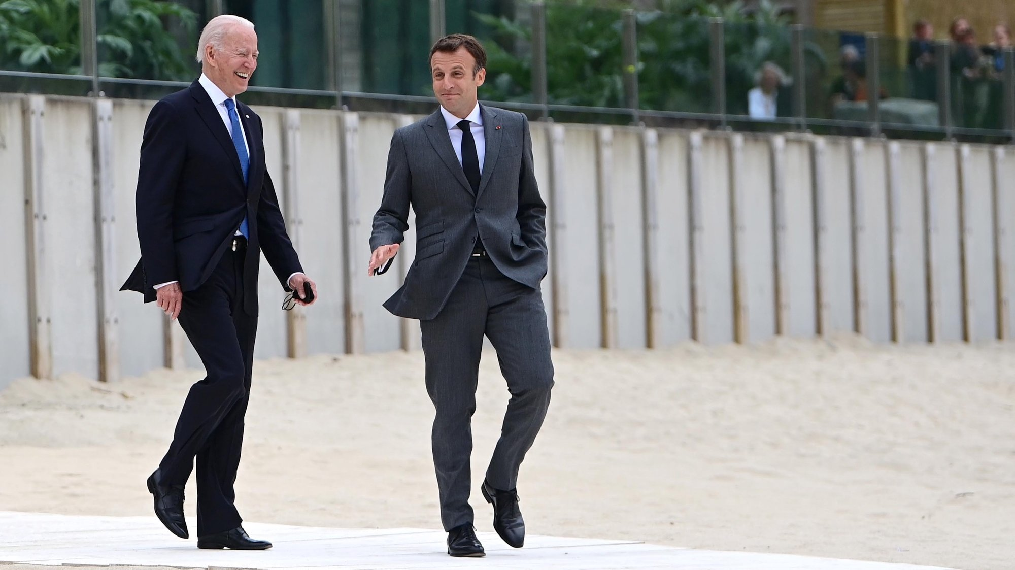 epa09262534 US President Joe Biden (L) and France's President Emmanuel Macron (R) arrive at the family photo during the G7 Summit in Carbis Bay, Britain, 11 June 2021. Britain hosts the Group of Seven (G7) summit in Cornwall from 11 to 13 June 2021.  EPA/NEIL HALL/POOL
