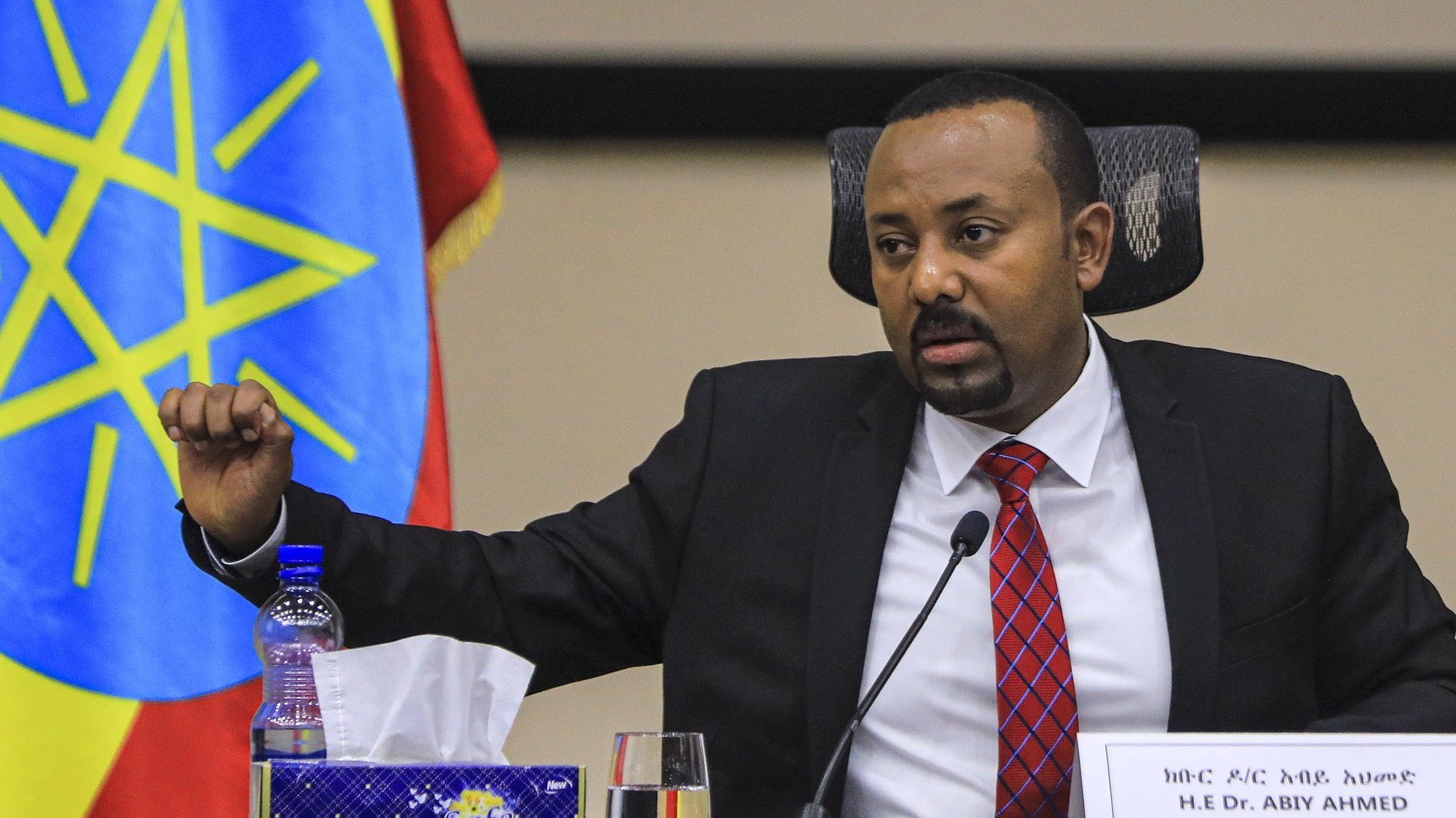 epa08852855 Ethiopian Prime Minister Abiy Ahmed speaks during a question and answer session in parliament, Addis Ababa, Ethiopia 30 November 2020. Ethiopia's military intervention in the northern Tigray region comes after Tigray People's Liberation Front (TPLF) forces allegedly attacked an army base on 03 November 2020 sparking weeks of unrest with over 40,000 refugees fleeing to Sudan.  EPA/STR