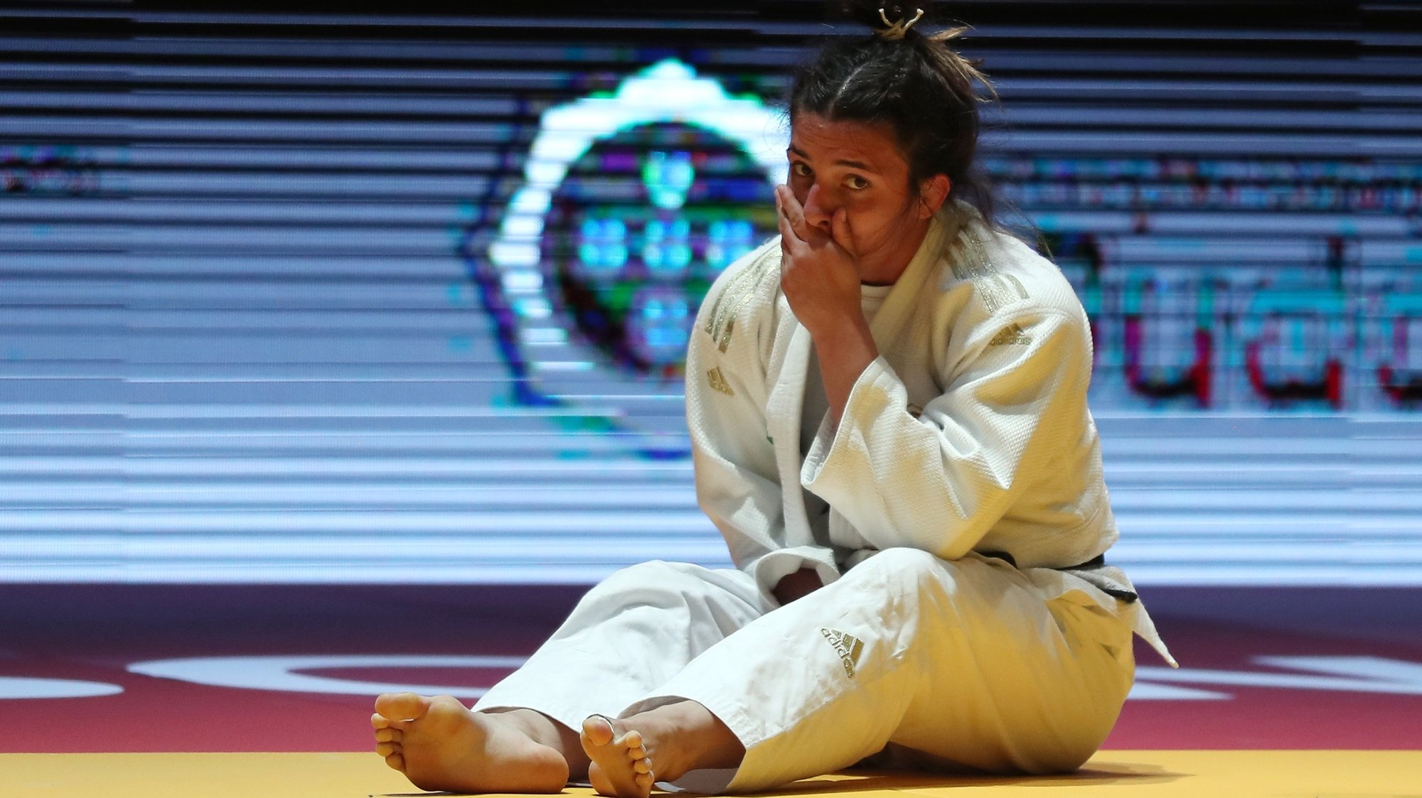 epa09141933 Barbara Timo of Portugal cryes after winning the bronze medal match against Lara Cvjetko of Croatia in woman's -70kg category at the European Judo Championships in Lisbon, Portugal, 17 April 2021.  EPA/NUNO VEIGA