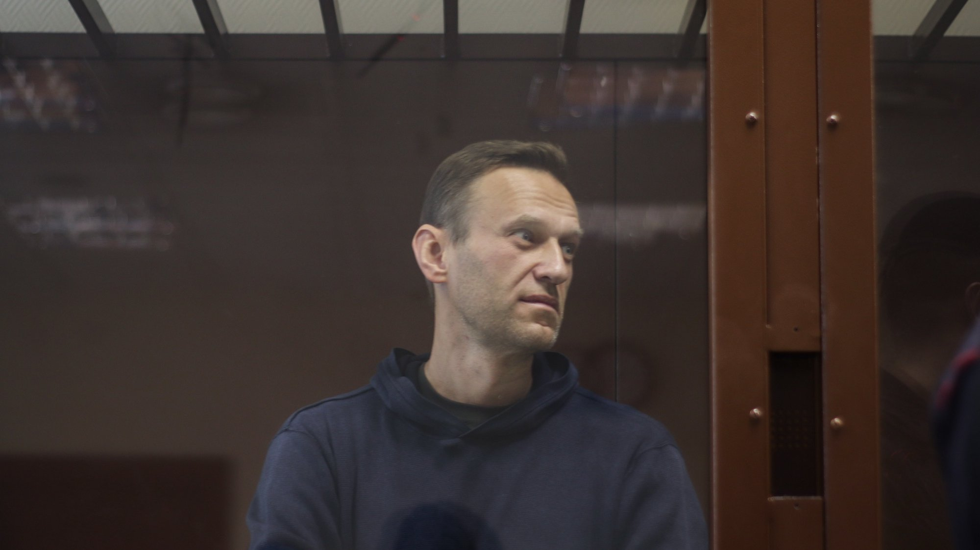 epa08988498 A handout photo made available by the Press Service of the Babushkinsky district court shows Russian opposition leader Alexei Navalny during a hearing of a case on slander charges in Moscow, Russia, 05 February 2021. In June 2020 the Russian Investigative Committee opened a criminal case against Alexei Navalny on charges of slander against WWII veteran Ignat Artemenko after Navalny's comment about a video promoting the amendments to the Russian Constitution.  EPA/BABUSHKINSKY DISTRICT COURT PRESS SERVICE / HANDOUT  HANDOUT EDITORIAL USE ONLY/NO SALES
