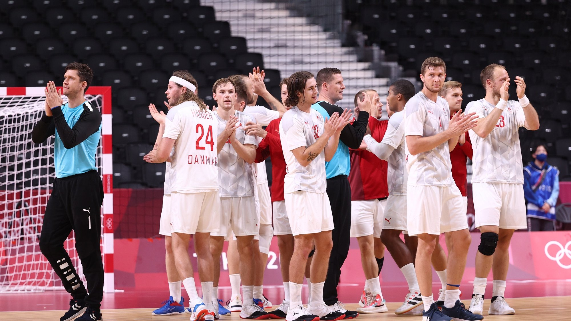 epa09379818 Players of Denmark celebrate after the Men's Handball preliminary round match between Portugal and Denmark at the Tokyo 2020 Olympic Games at the Yoyogi National Gymnasium arena in Tokyo, Japan, 30 July 2021.  EPA/WU HONG