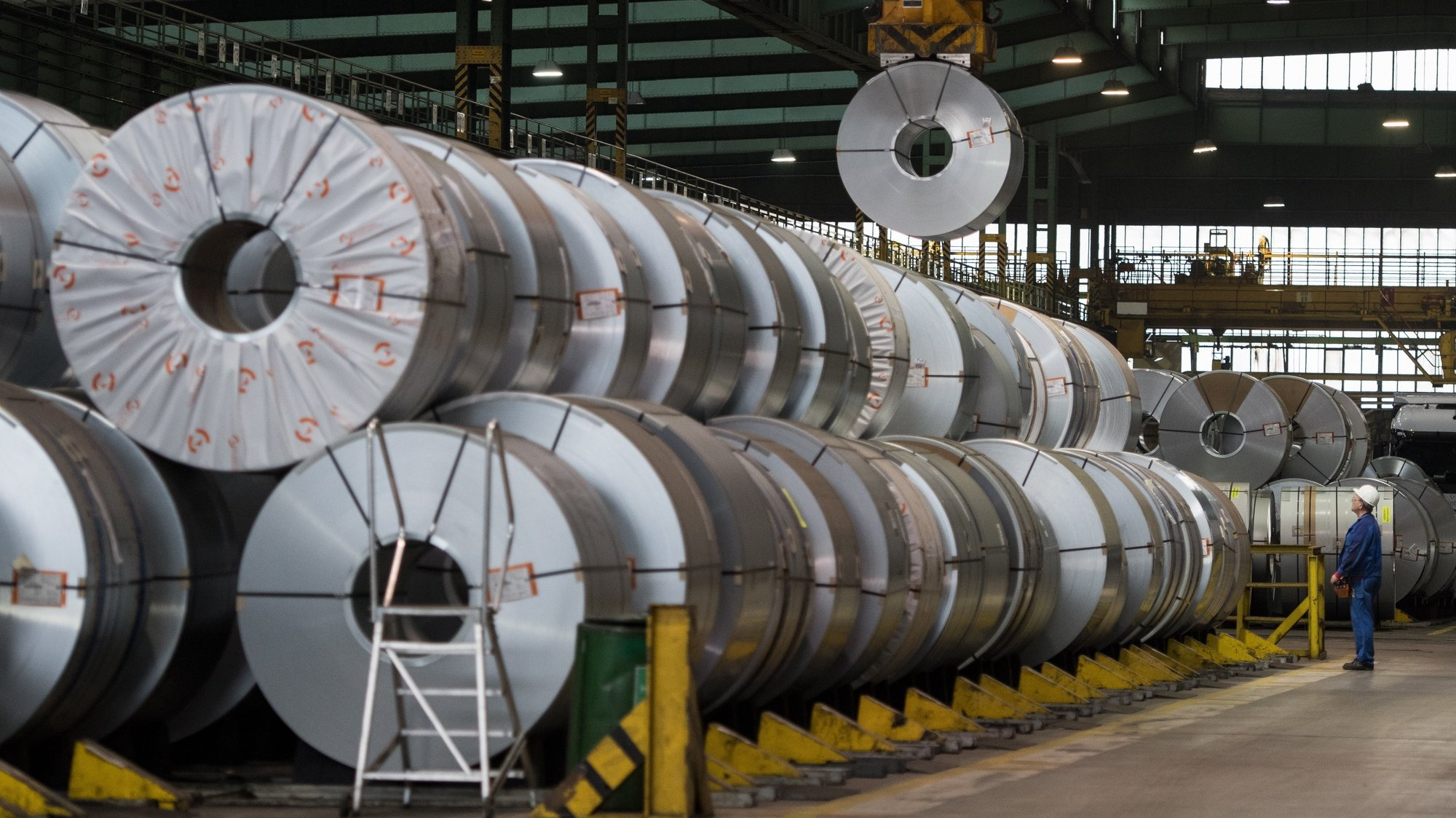 epa07478087 (FILE) - A worker stores steel collies from the Salzgitter AG in Salzgitter, Germany, 22 March 2018 (reissued 01 April 2019). Reports on 01 April 2019 state the IHS Markit institute reporting German purchasing manager index has fallen 3,5 points to 44,1 points, an 80-month low and its lowest figure since 2012. The incoming orders and orders for export have both suffered from a decline not seen since the global financial crisis, the institute said. For the Eurozone, IHS Markit's final Eurozone manufacturing PMI stood at 47,5 points in March, down from February's final figure 49,3 points, marking its biggest monthly decline in new orders since the end of 2012.  EPA/DAVID HECKER