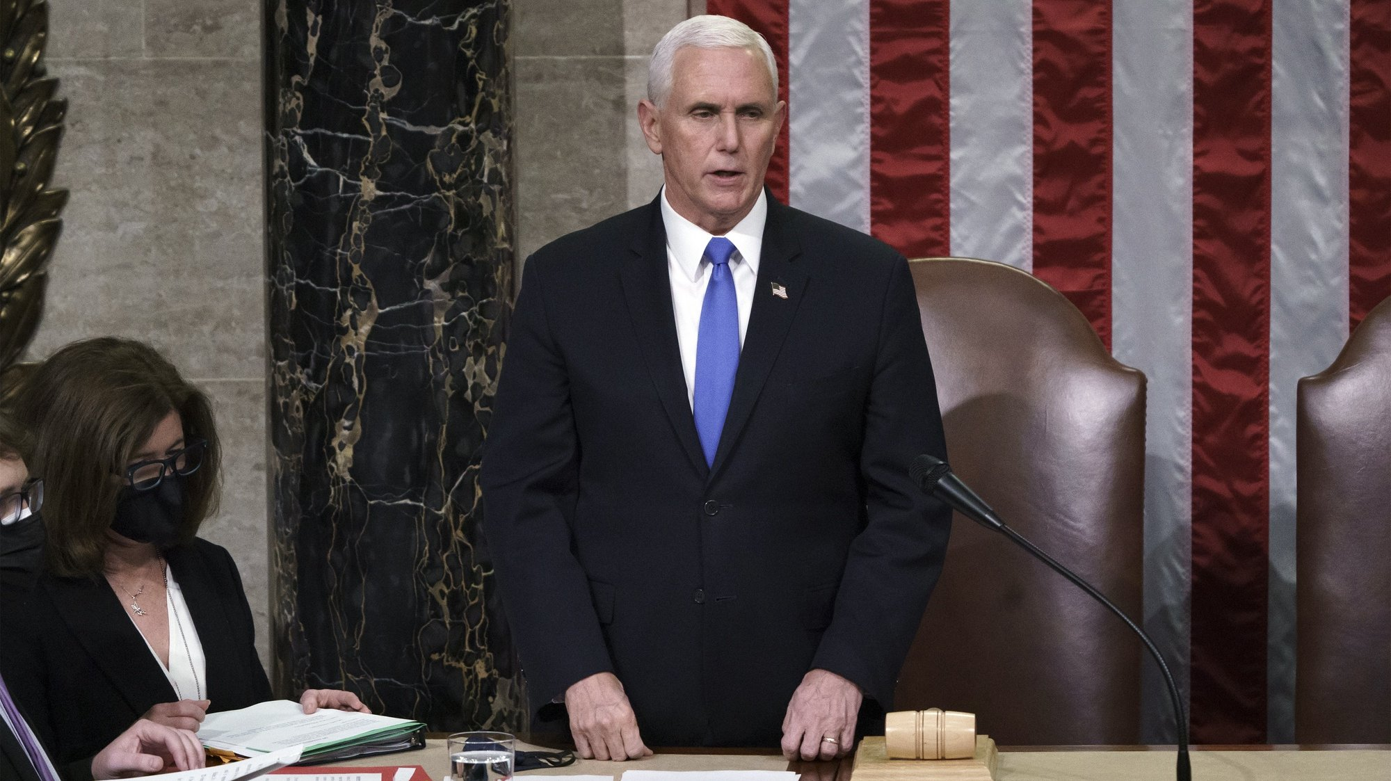 epa08924151 Vice President Mike Pence reads the final certification of Electoral College votes cast in November's presidential election during a joint session of Congress after working through the night, at the Capitol in Washington, DC, USA, 07 January 2021. Violent protesters loyal to President Donald Trump stormed the Capitol, disrupting the process.  EPA/J. Scott Applewhite / POOL  POOL