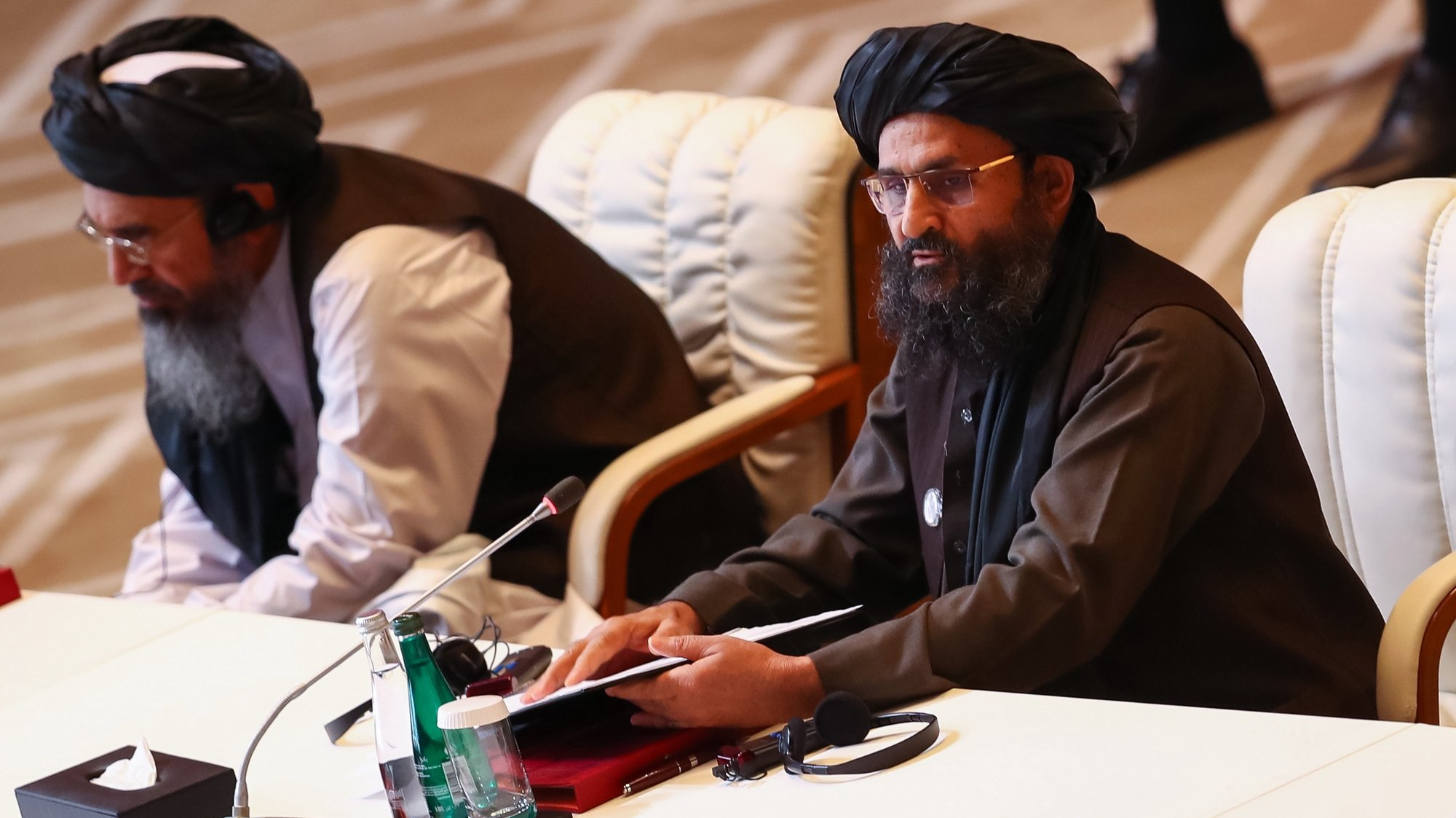 epa08663248 Taliban co-founder Mullah Abdul Ghani Baradar (R) speaks during the opening session of the peace talks between the Afghan government and the Taliban  in Doha, Qatar, 12 September 2020. The United States, Taliban and Afghanistan government delegations officially began the intra-Afghan negotiations on 12 September 2020.  EPA/STRINGER