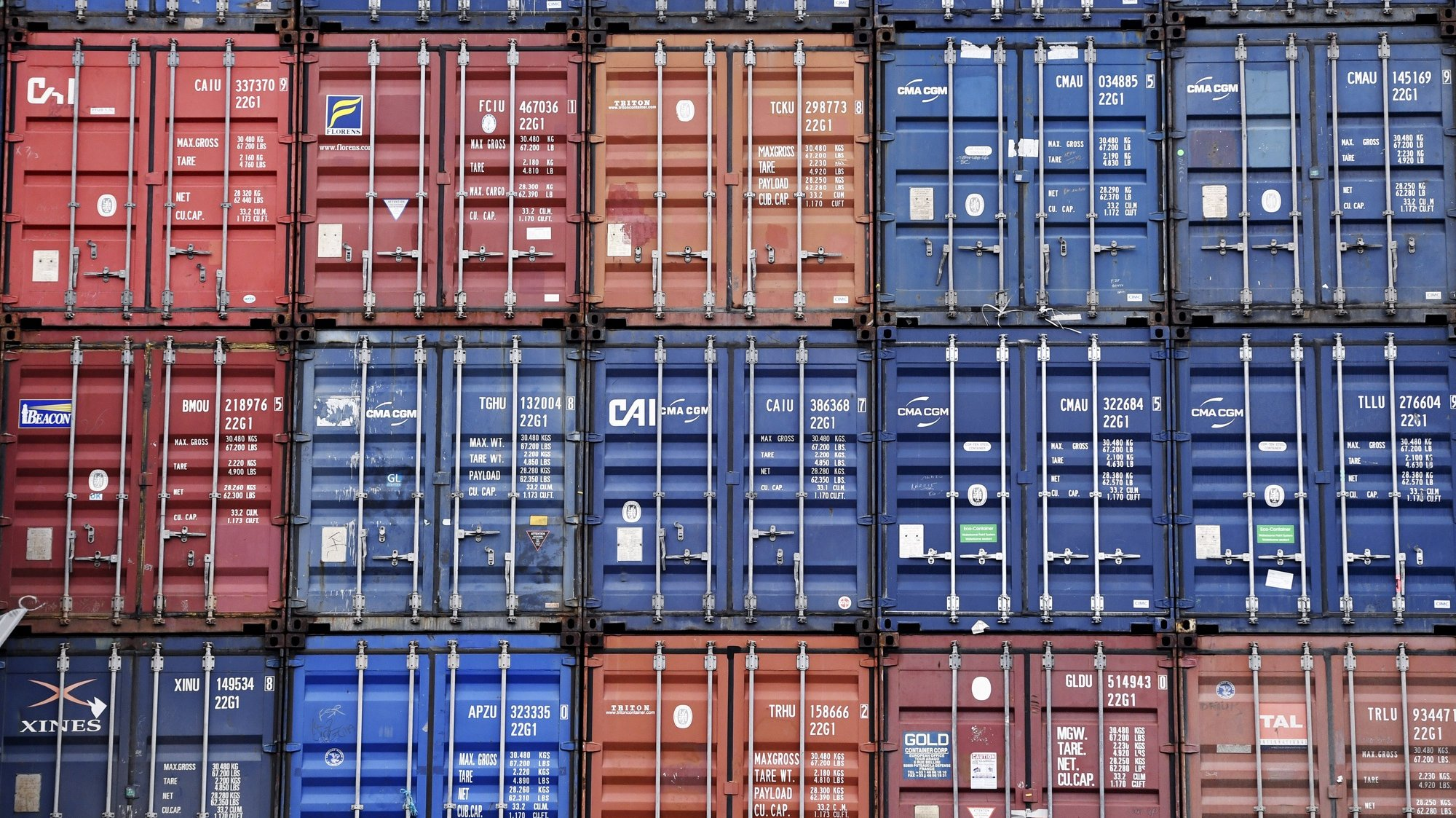 epa08878774 Stacked shipping containers in Dublin port in Dublin, Ireland, 12 December 2020. Brexit negotiations continue in Brussles before the 13 December deadline before Britain leaves the EU on 01 January 2021.  EPA/AIDAN CRAWLEY