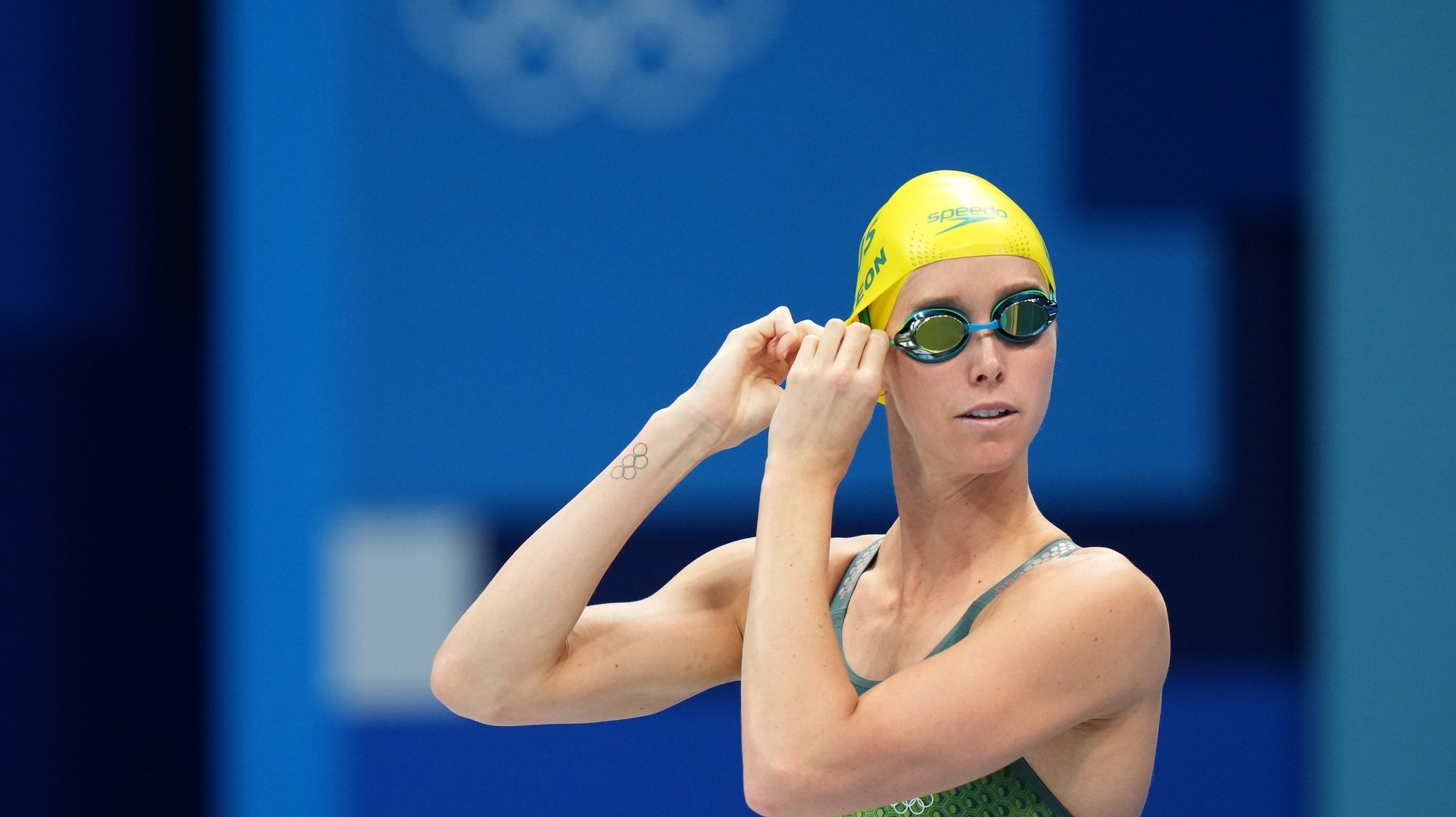 epa09365724 Emma McKeon of Australia prepares before her Bronze medal swim in the Women's 100m Butterfly Final during the Tokyo Olympic Games, at the Tokyo Aquatics Centre in Tokyo, Japan, 26 July 2021.  EPA/JOE GIDDENS AUSTRALIA AND NEW ZEALAND OUT