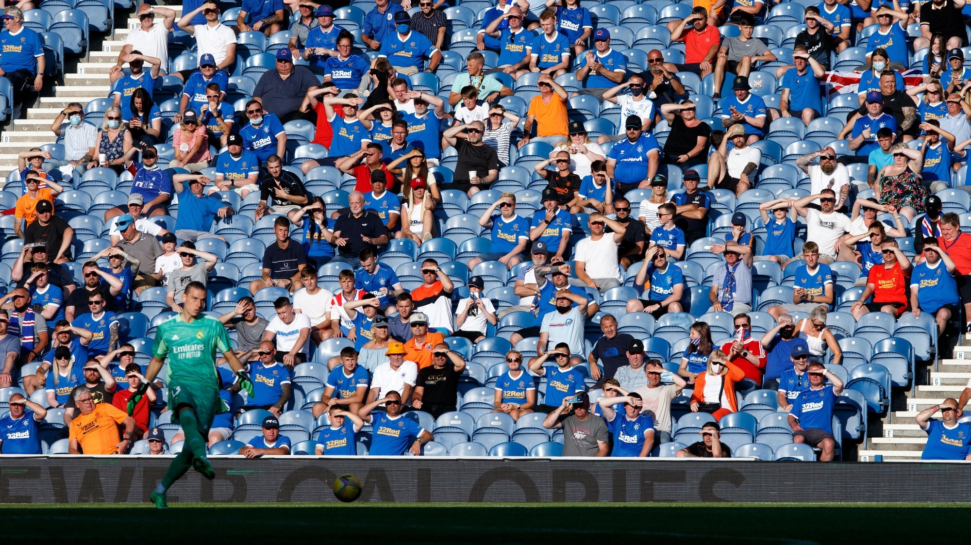 epa09365515 Rangers fans attend the pre-season friendly test soccer match between Glasgow Rangers and Real Madrid at Ibrox Stadium in Glasgow, Britain, 25 July 2021.  EPA/Robert Perry