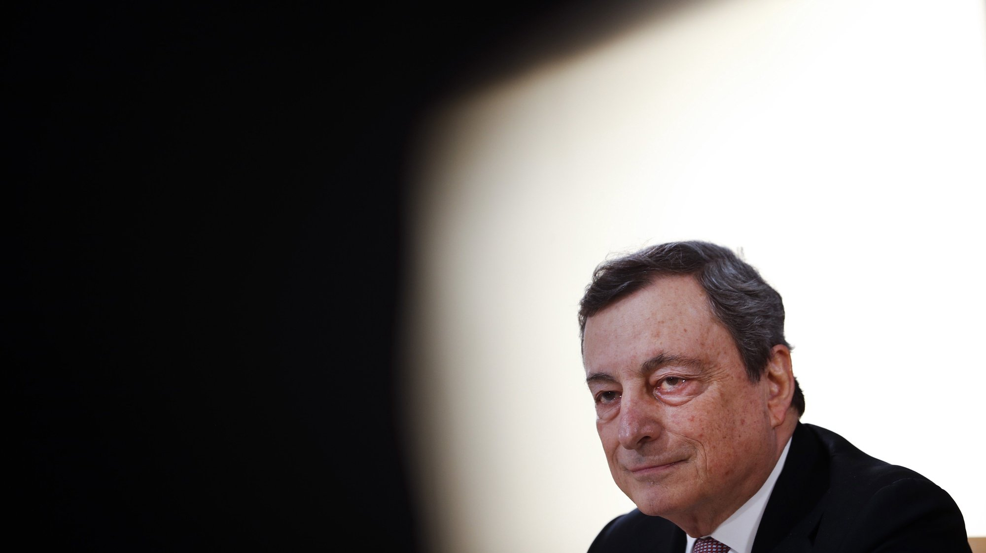 epa09185042 Italy's Prime Minister Mario Draghi speaks during a media conference at an EU summit in Porto, Portugal, 08 May 2021. On 08 May, EU leaders hold an online summit with India's Prime Minister Narendra Modi, covering trade, climate change and help with India's COVID-19 surge.  EPA/Francisco Seco / POOL