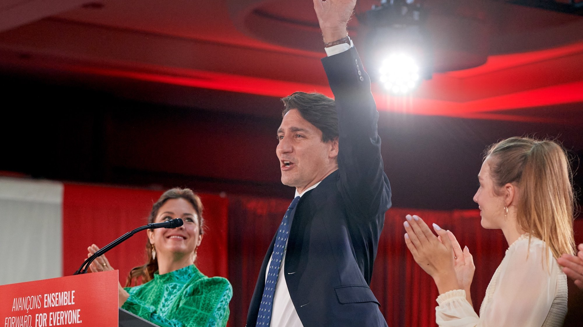 epa09478683 Canadian Prime Minister and Liberal Party leader Justin Trudeau (C), next to his wife Sophie Gregoire (L) and daughter Ella Grace (R), waves to supporters as he celebrates his election victory in Montreal, Quebec, Canada, 20 September 2021. Liberal Party leader Justin Trudeau retained his position as Canadian prime minister in the federal election but will be forced to form a minority government.  EPA/ERIC BOLTE