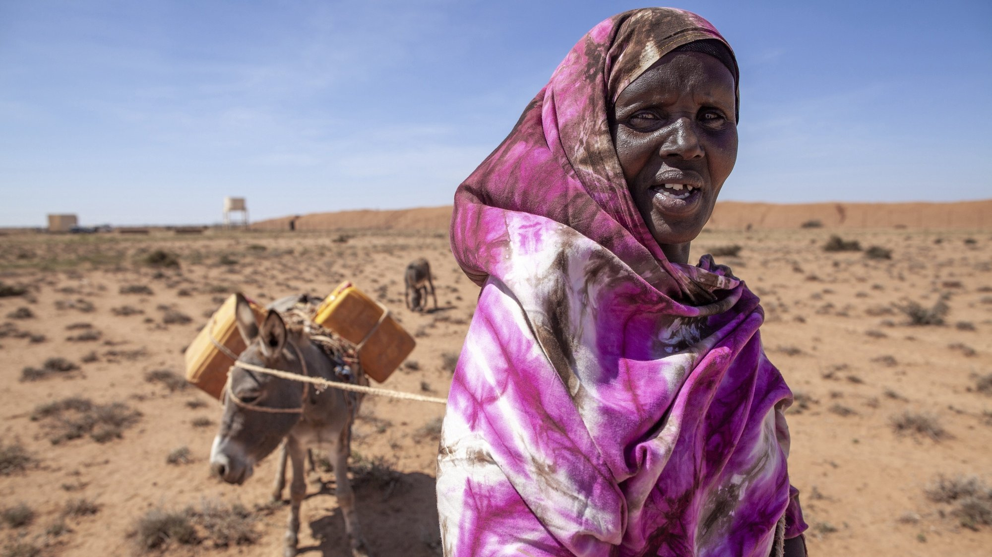 epa08219014 A handout photo made available by the United Nations Development Programme (UNDP) shows Fardosa Mohamed, a fifty-year-old pastoralist, searching for water in Baligubadle, Somaliland, the autonomous region of Somalia, 03 December 2019 (issued 15 February 2020). Somali pastoralists are particularly vulnerable to climate-induced phenomenon like drought and flooding.  EPA/MARK NAFTALIN / UNITED NATIONS DEVELOPMENT PROGRAMME HANDOUT  HANDOUT EDITORIAL USE ONLY/NO SALES