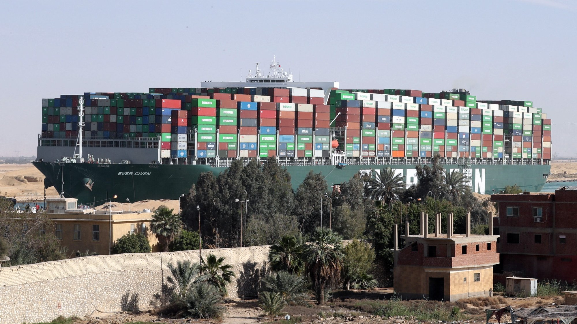 epa09134869 (FILE) - The container ship 'Ever Given' is moving in the Suez Canal, Egypt, 29 March 2021 (reissued 14 April 2021). The Suez Canal Authority (SCA) has seized the ship over an unsettled claim of over 900 Million US dollars for compensation, the Ever Given's insurer UK Club said. The Ever Given ran aground in the Suez Canal on 23 March, causing a huge traffic backlog of ships.  EPA/KHALED ELFIQI *** Local Caption *** 56794878