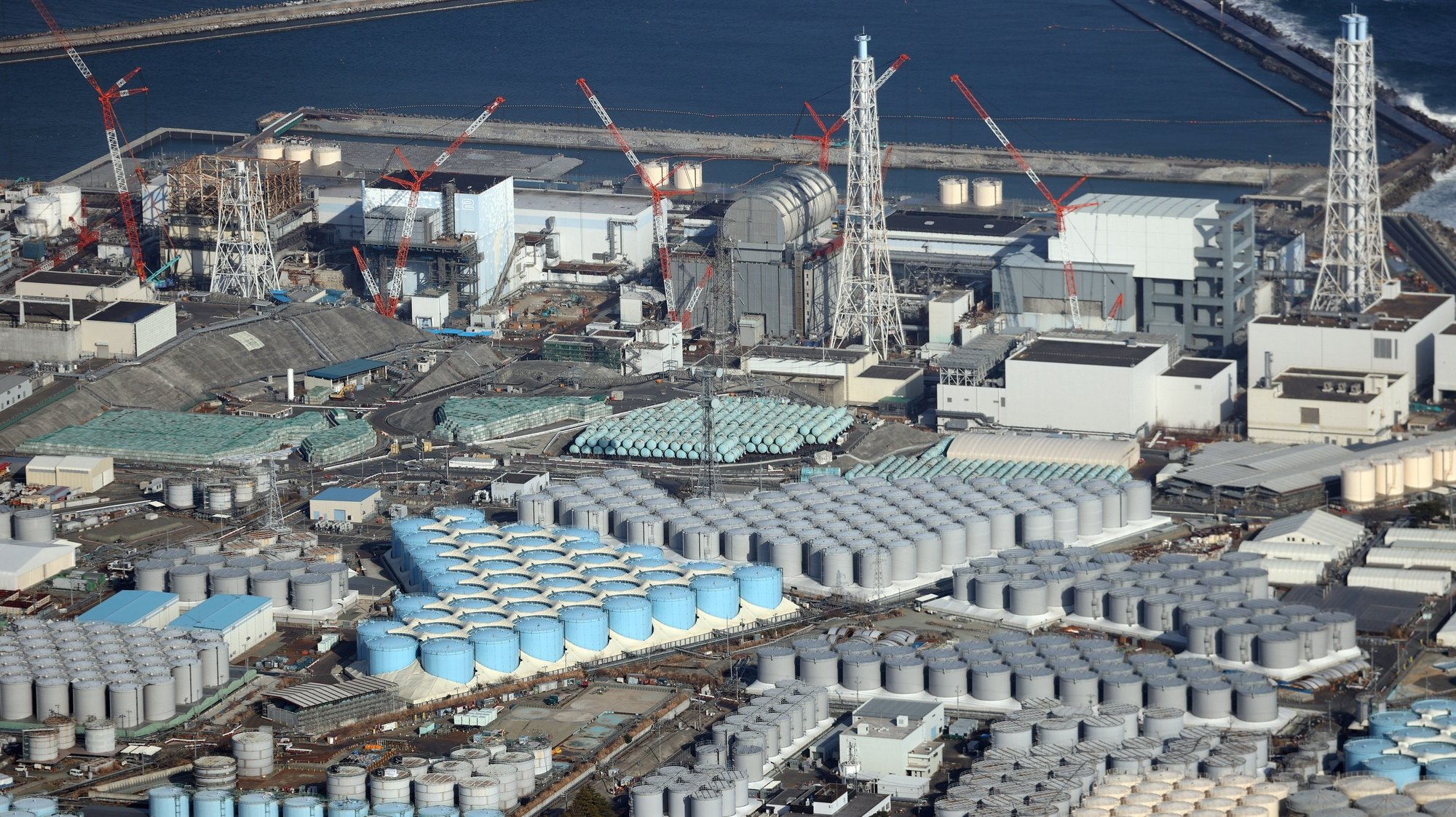 epa09131838 An aerial view shows tanks containing contaminated water at the Fukushima Daiichi nuclear power plant, which suffered meltdowns on 11 March 2011, in Fukushima prefecture, northeastern Japan, 14 February 2021 (reissued 13 April 2021). On 13 April 2021, the Japanese government officially decided to release treated water containing tritium from the crippled Fukushima Daiichi Nuclear Power Plant into the ocean.  EPA/JIJI PRESS JAPAN OUT EDITORIAL USE ONLY/  NO ARCHIVES